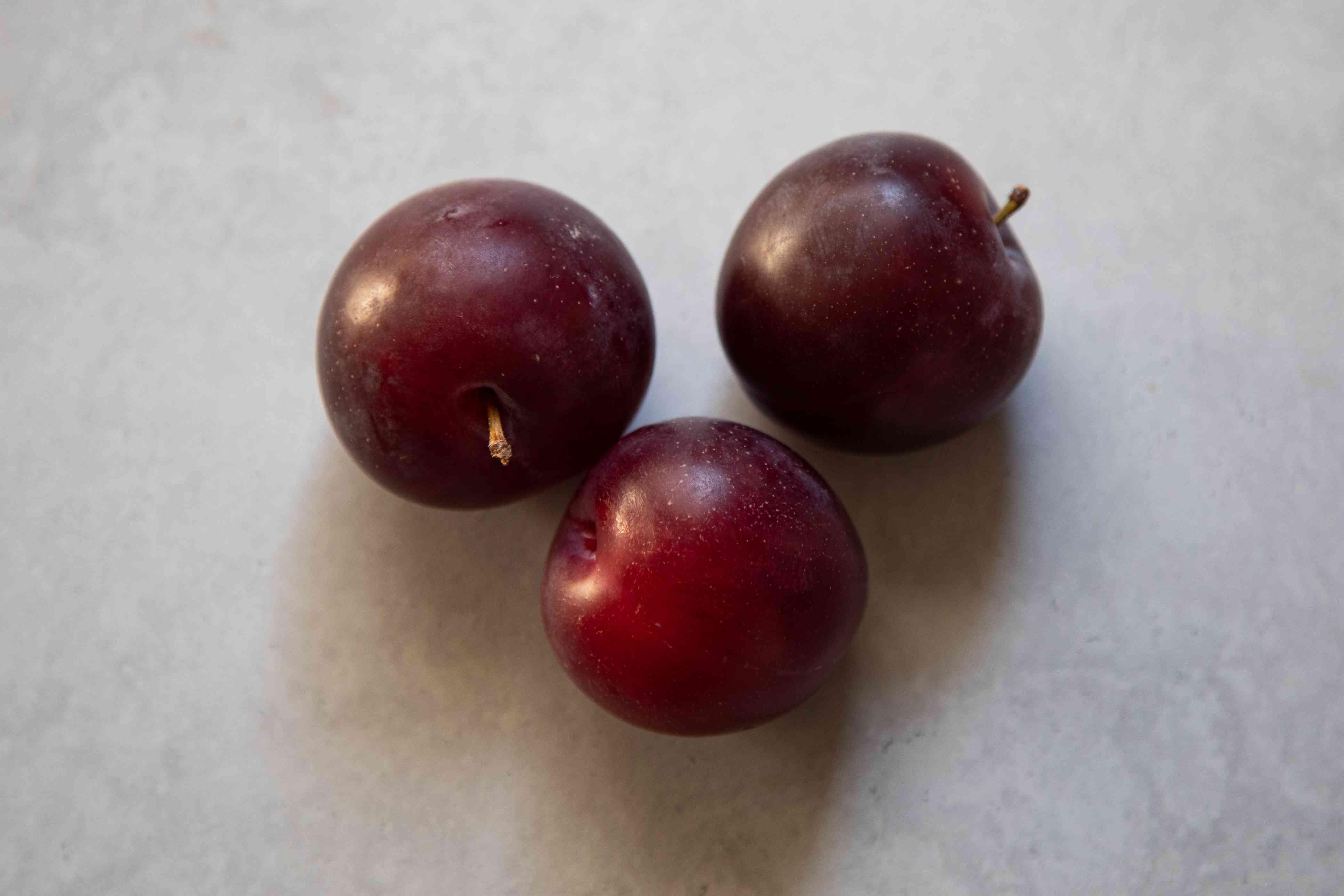 Three purple plums