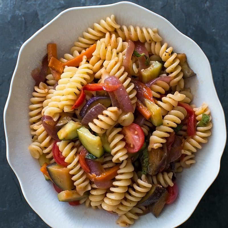 Pasta Primavera with veggies in white bowl