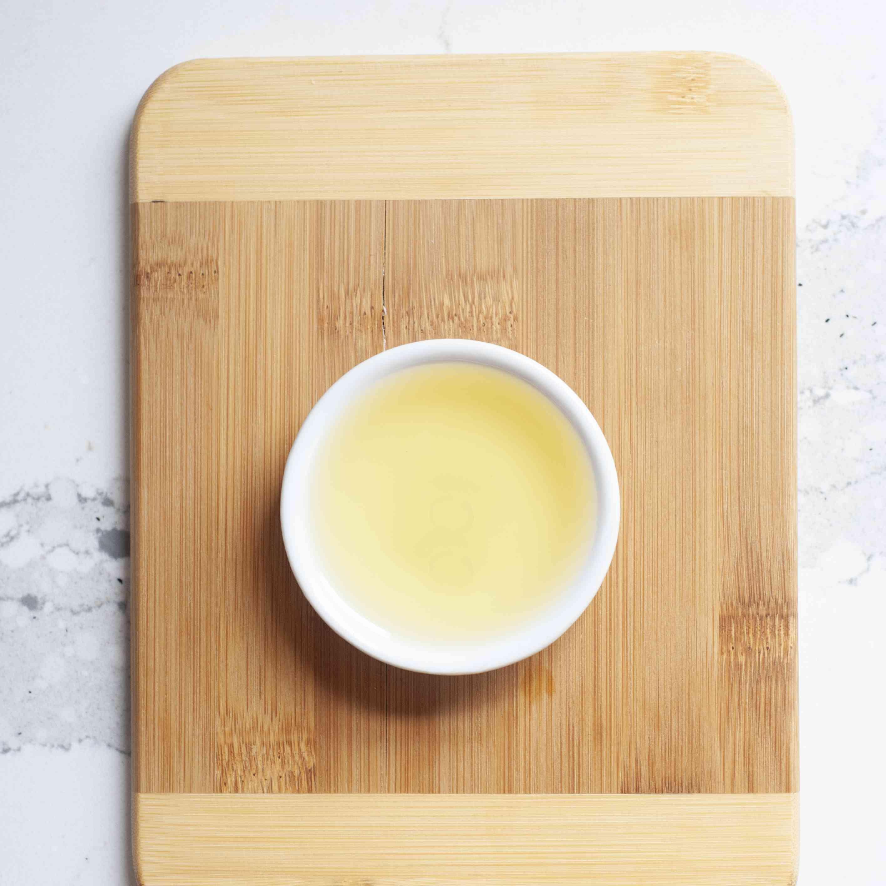Light colored regular untoasted sesame oil in white bowl