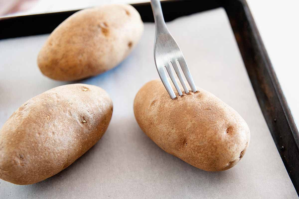 Oven Baked Potato Recipe - potatoes with forks