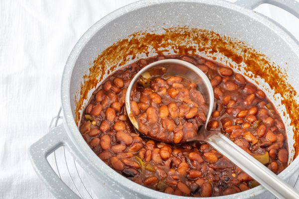 Overhead view of a pot of cowboy baked beans.