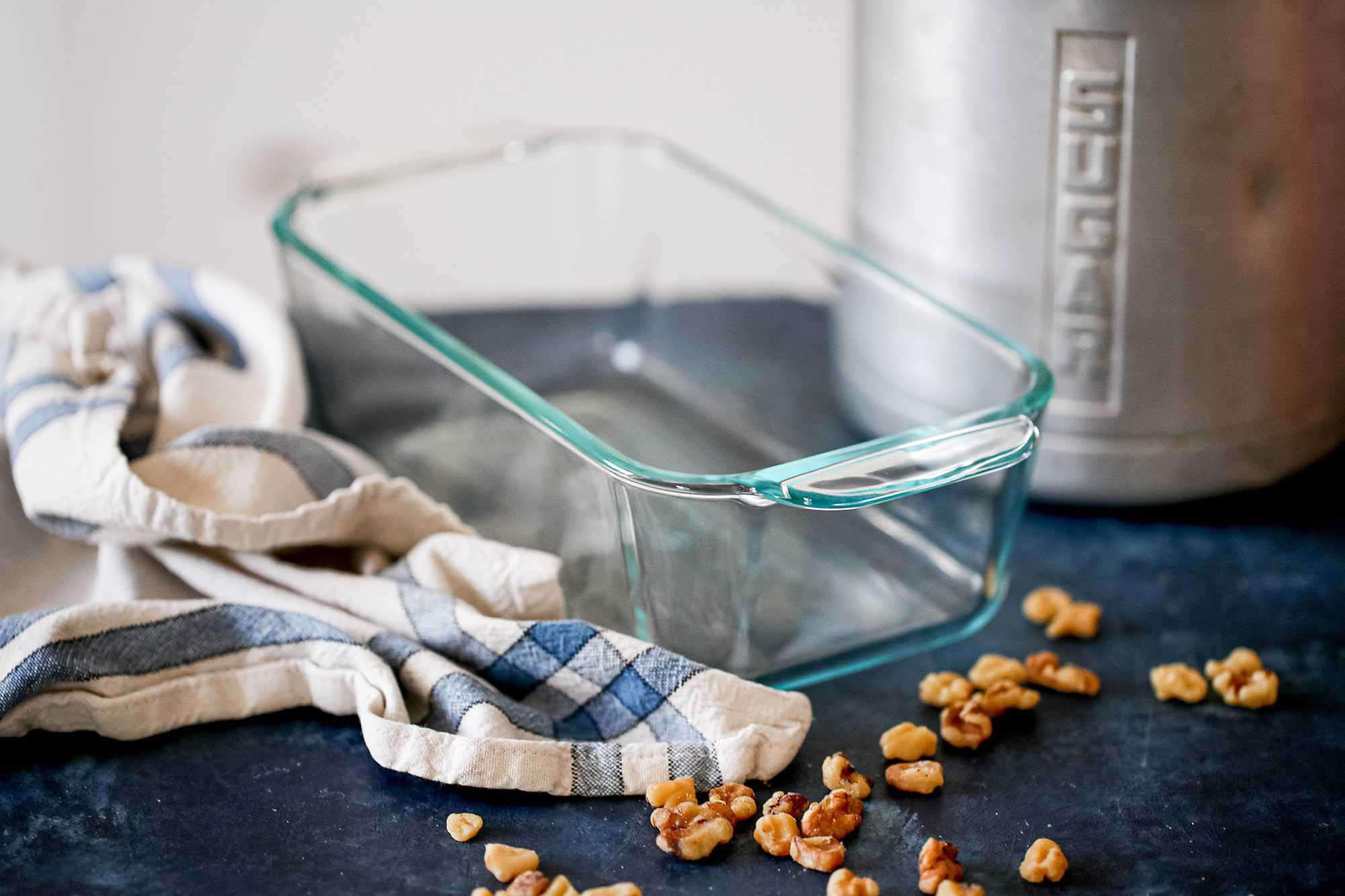 Glass Loaf Pan Guide - glass loaf pan with sugar container in the background