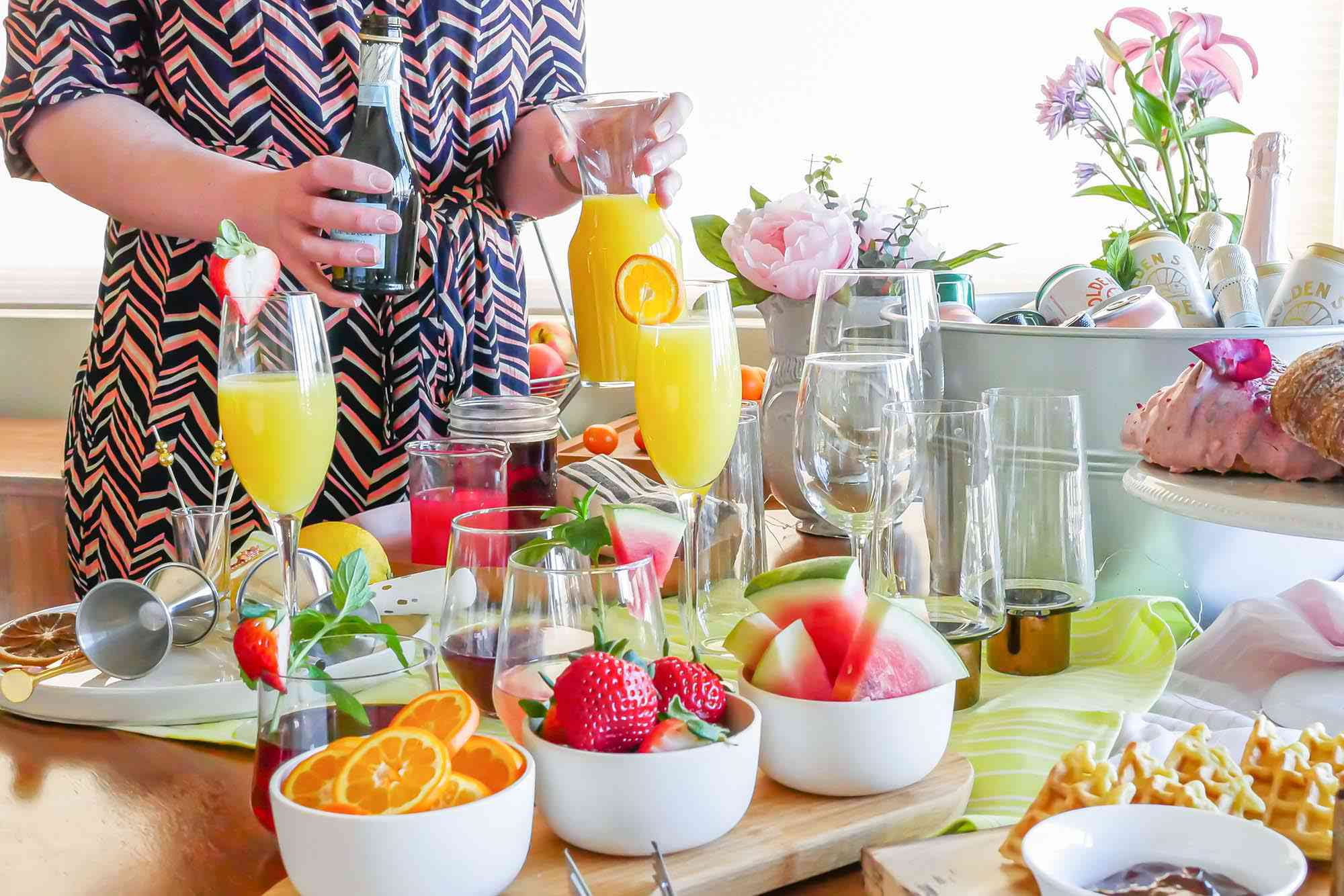 A Mimosa Bar for Any Occasion set with fruit and glassware.