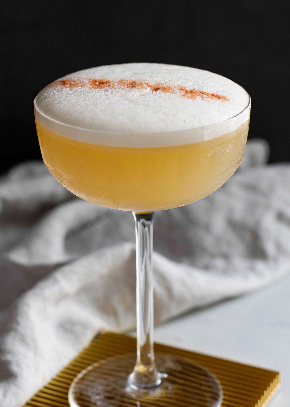 whiskey sour ingredients with an egg white