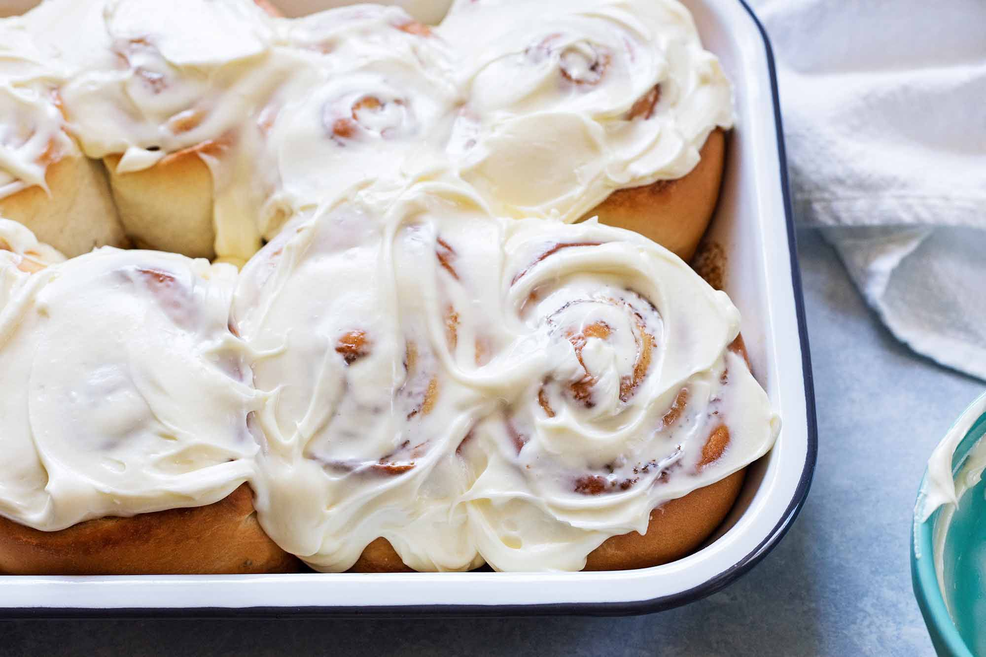 The best cinnamon rolls frosted with cream cheese frosting.