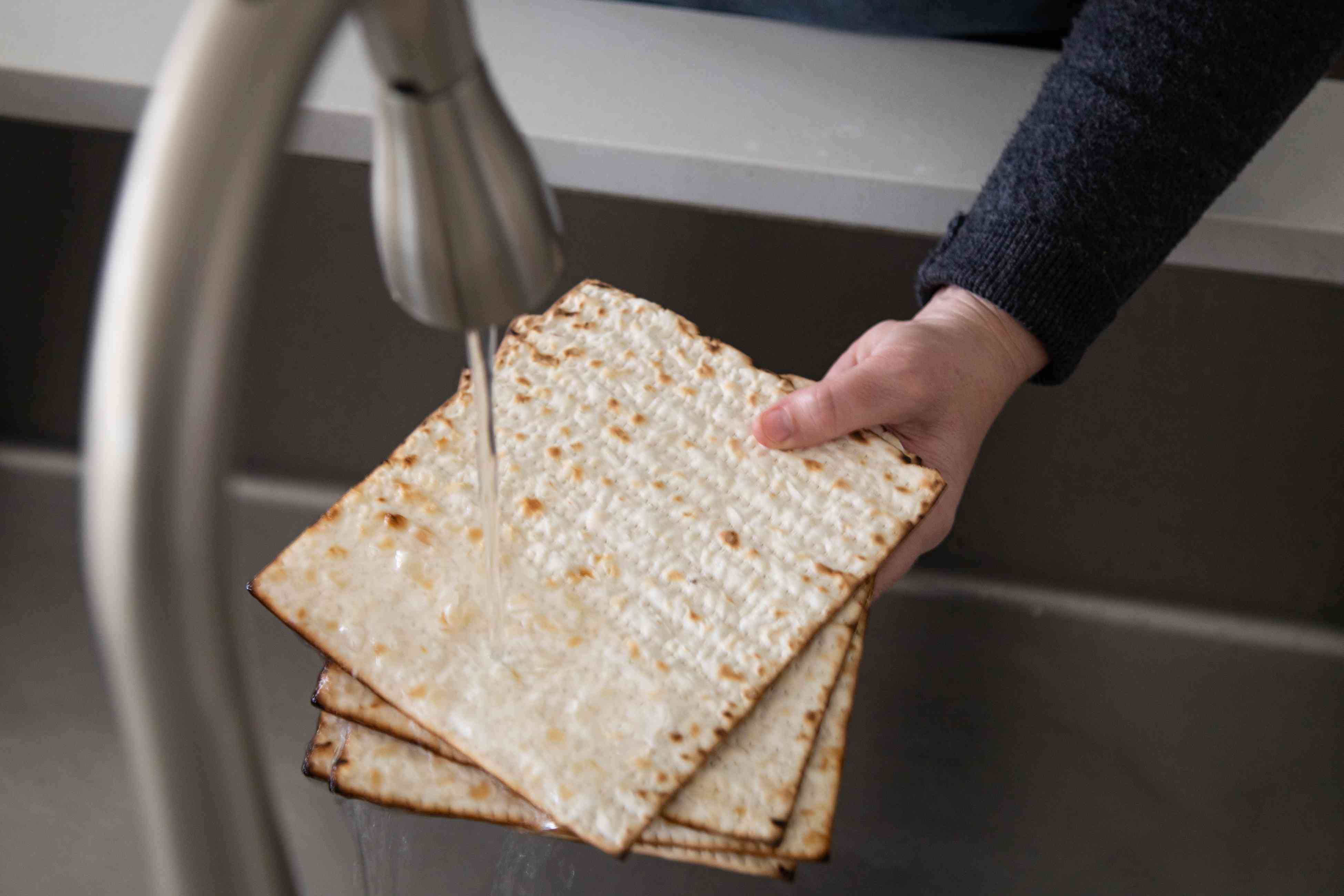 Running water over matzo crackers.