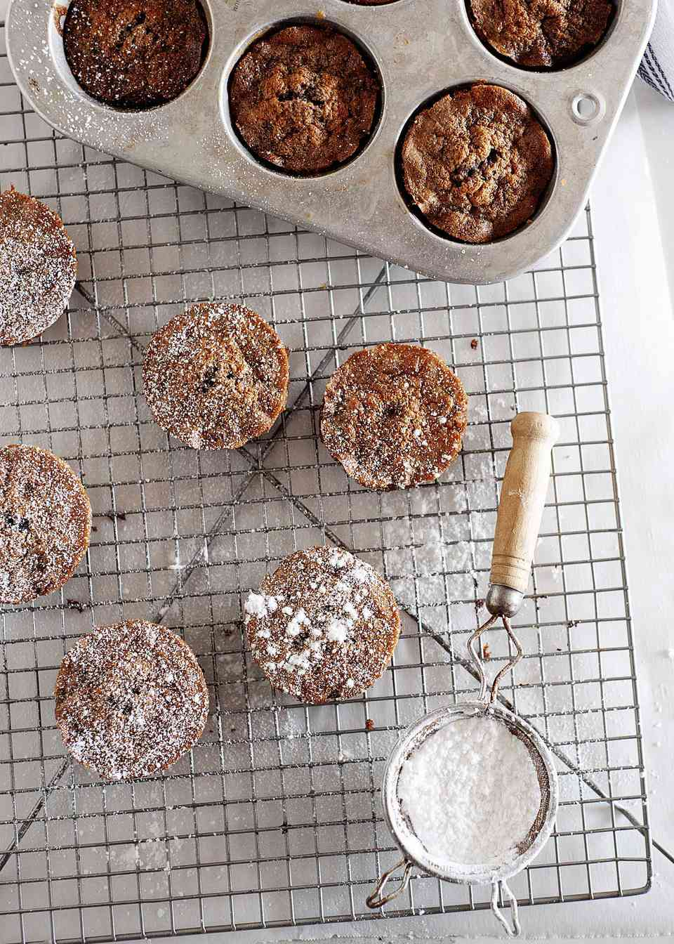 Paleo Chocolate Olive Oil Cakes on rack with powdered sugar