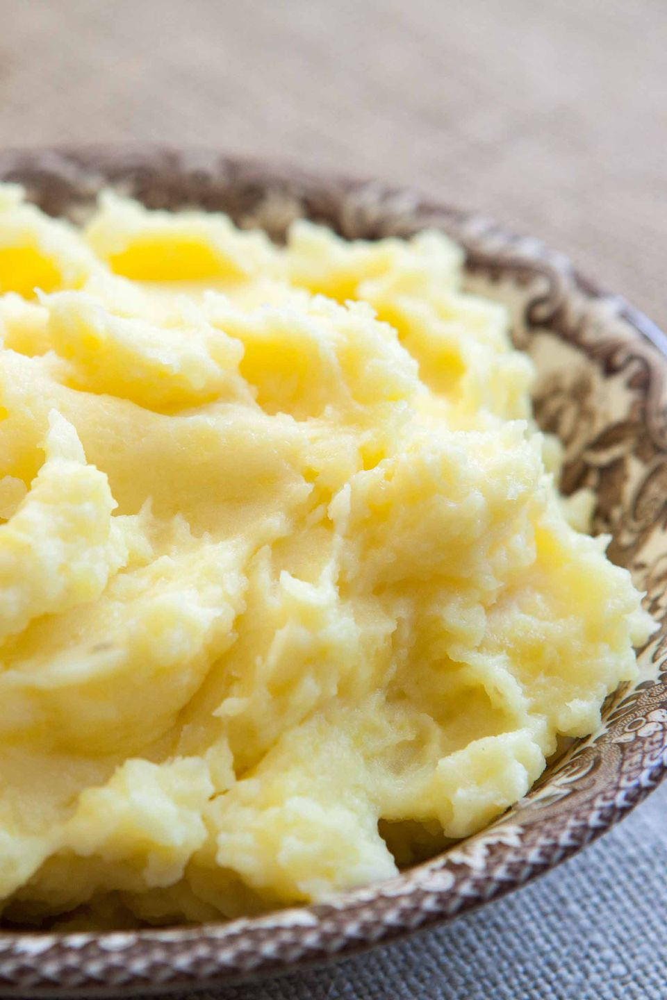 Close up of boiled potatoes mashed and in a bowl.