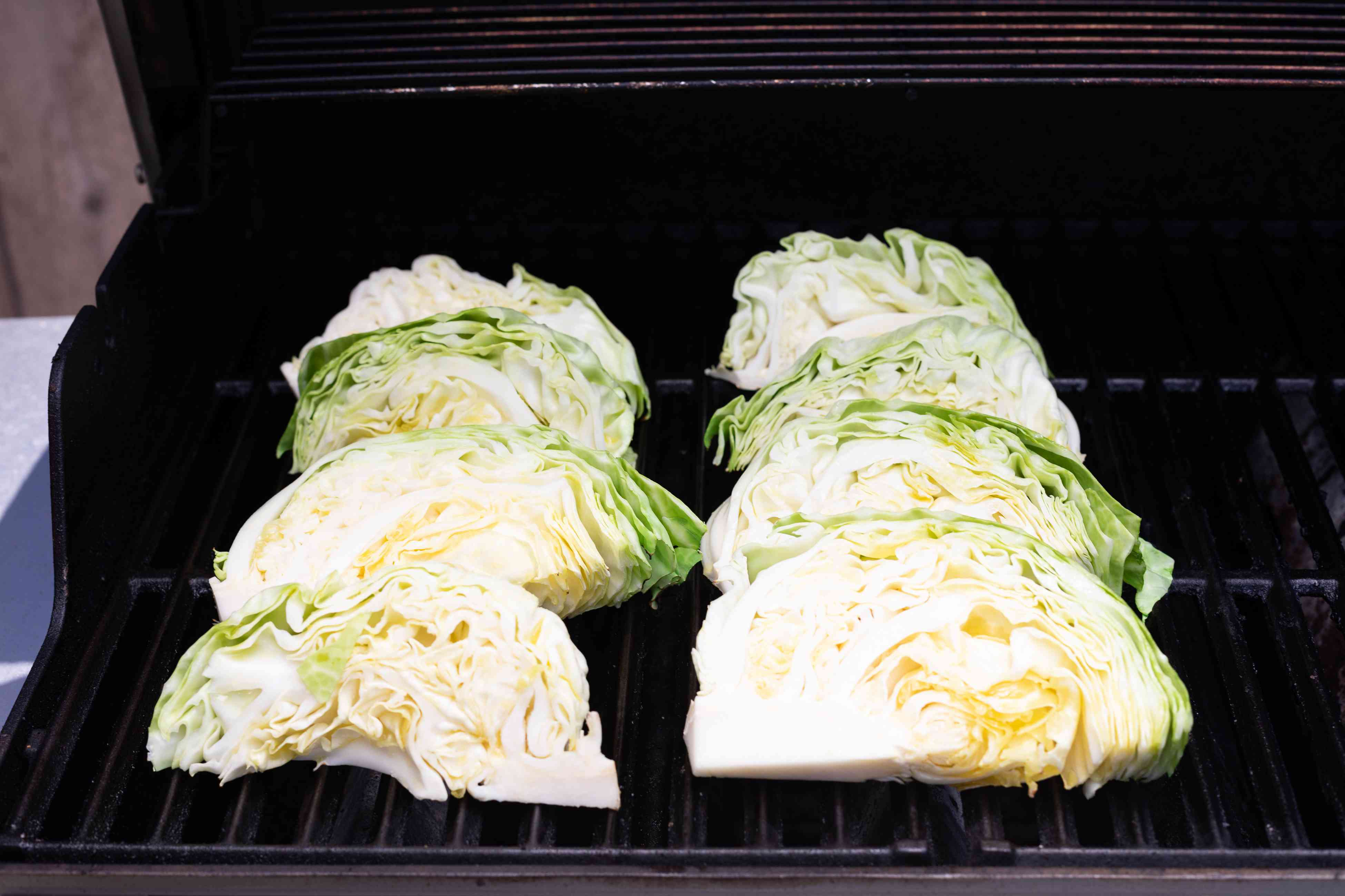 Cabbage wedges set on the grill for Grilled cabbage from Hetty McKinnon author of To Asia with Love