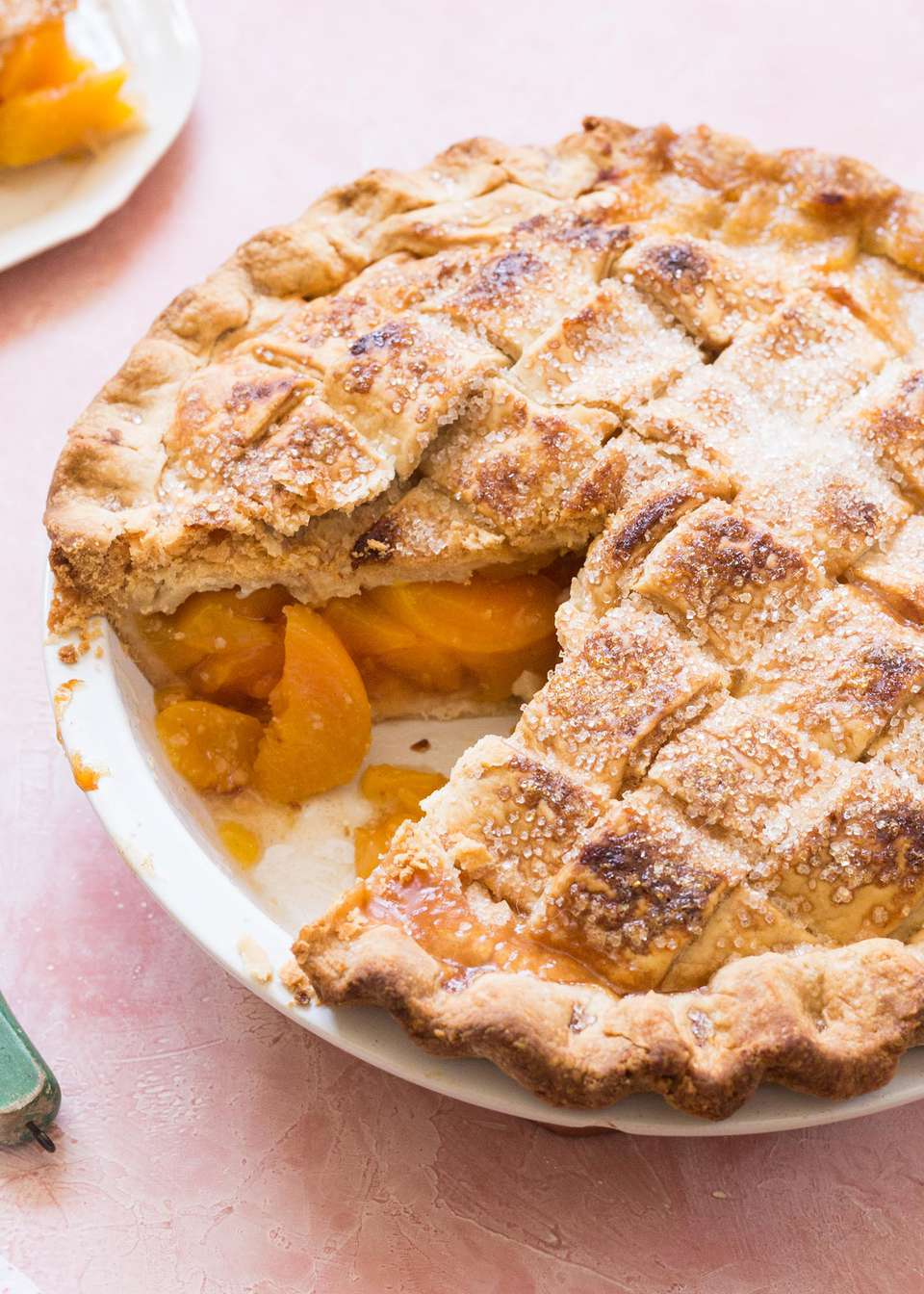 Homemade Peach Pie with one slice removed