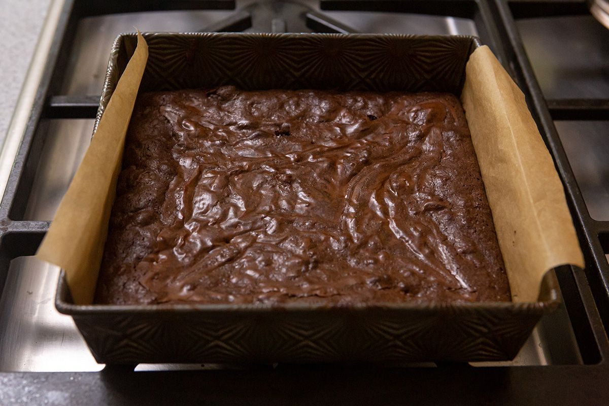 A pan of brownies cooling on the stovetop.