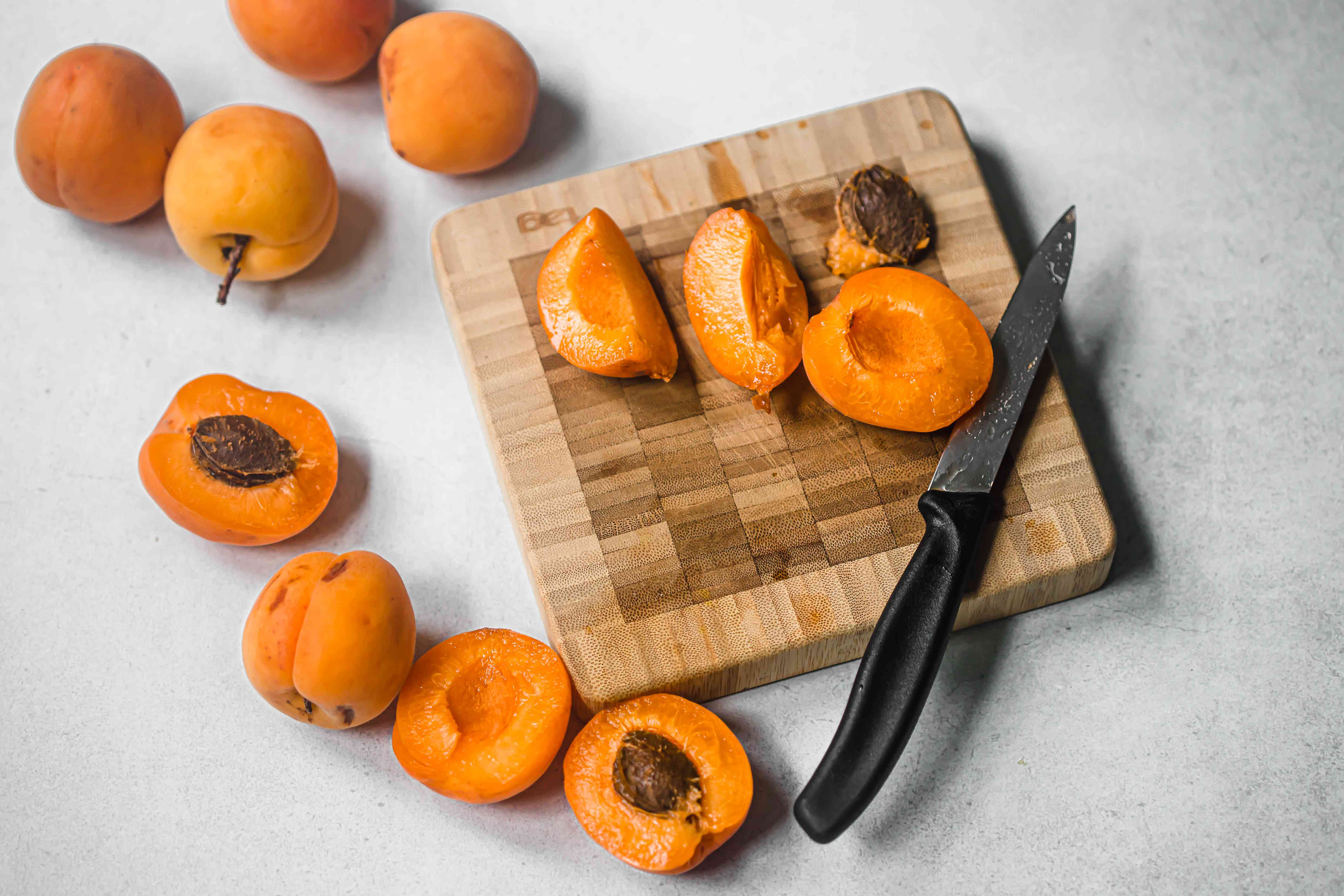 Apricots with a wooden cutting board