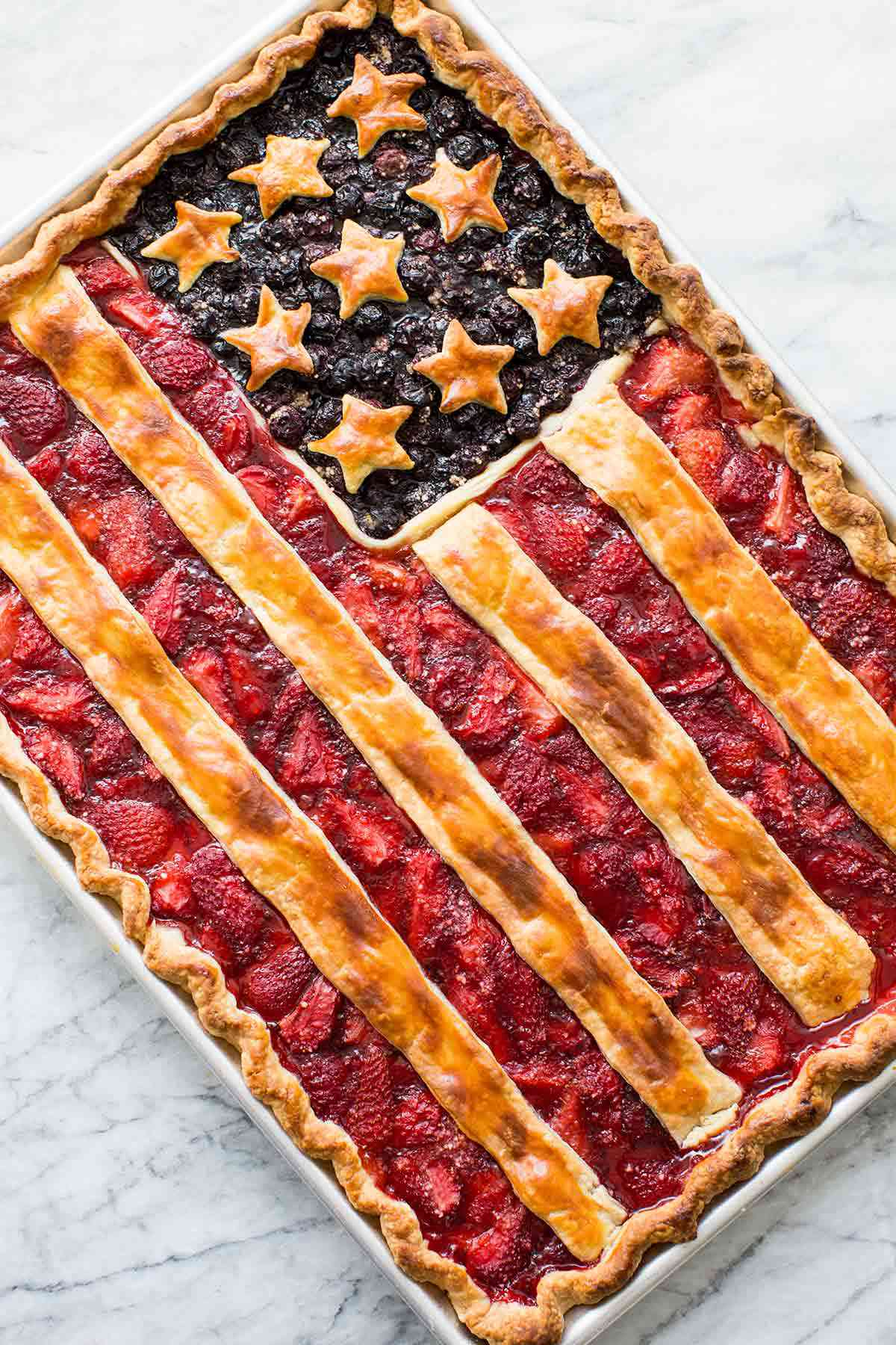 red white and blue American Flag Pie baked in a sheet pan with stars and stripes