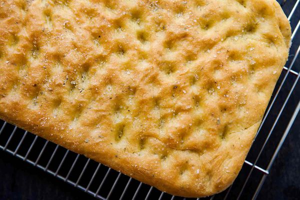 Easy focaccia bread with rosemary baked and cooling on a cooling rack