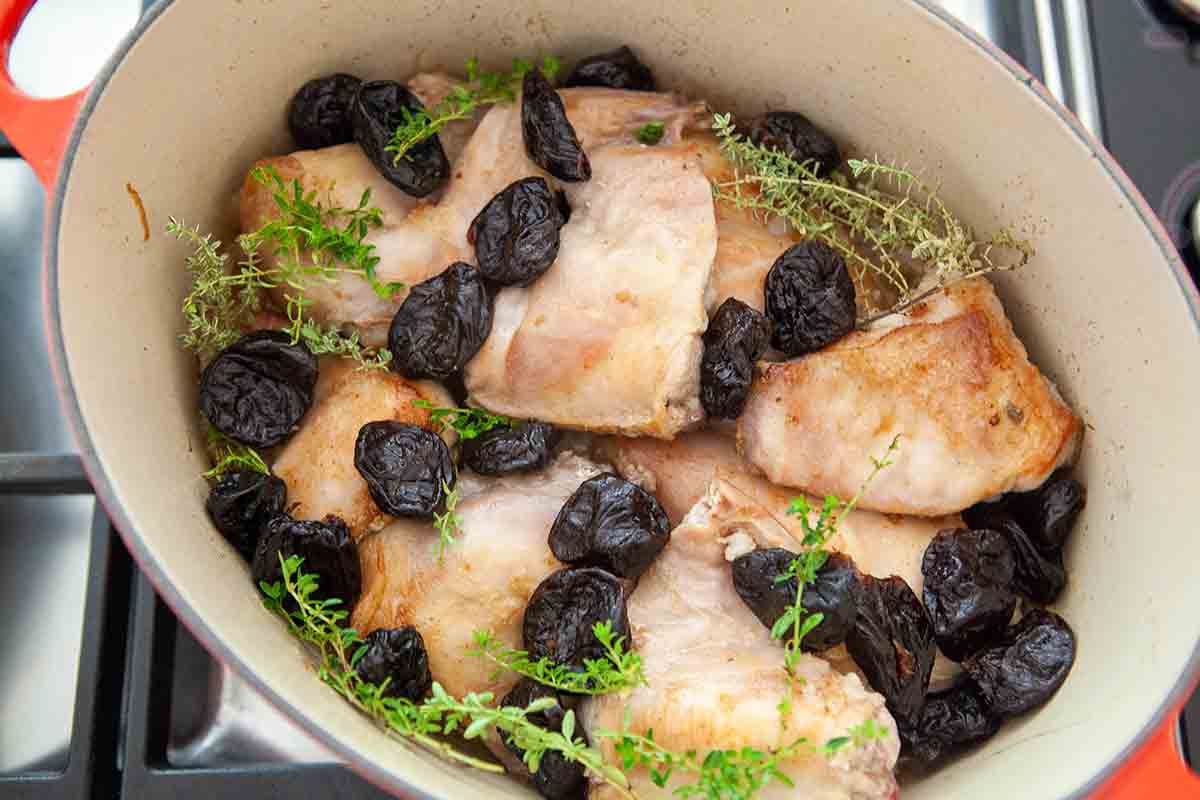 add prunes and thyme to rabbit in dutch oven