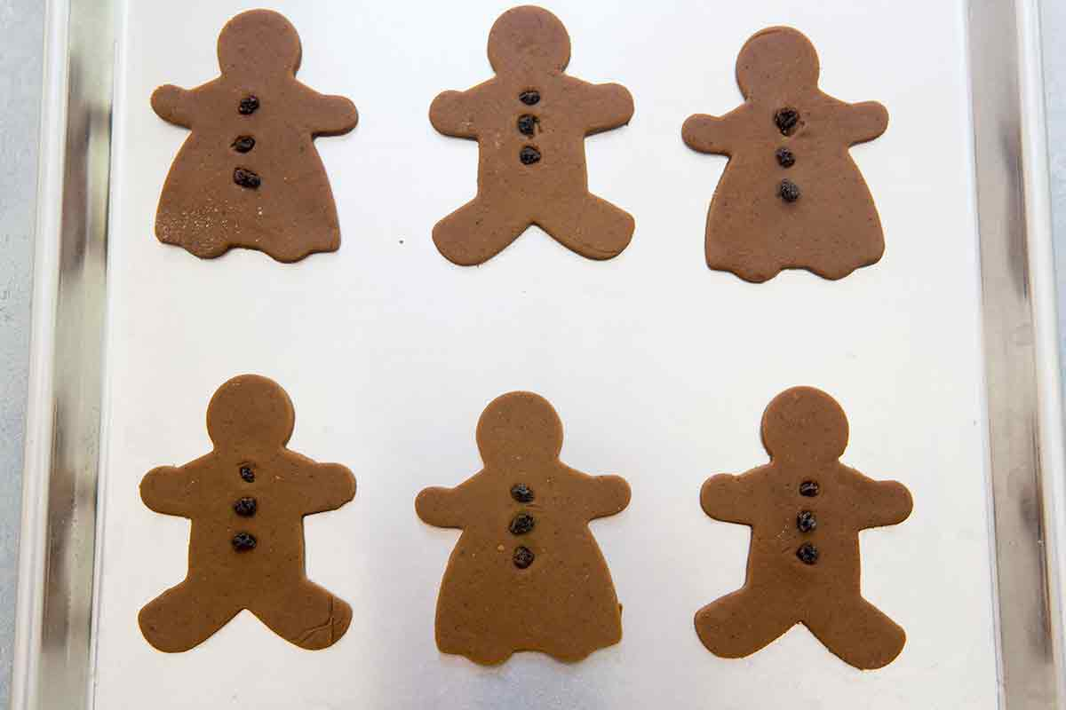 Six Gingerbread men and women with raisin buttons