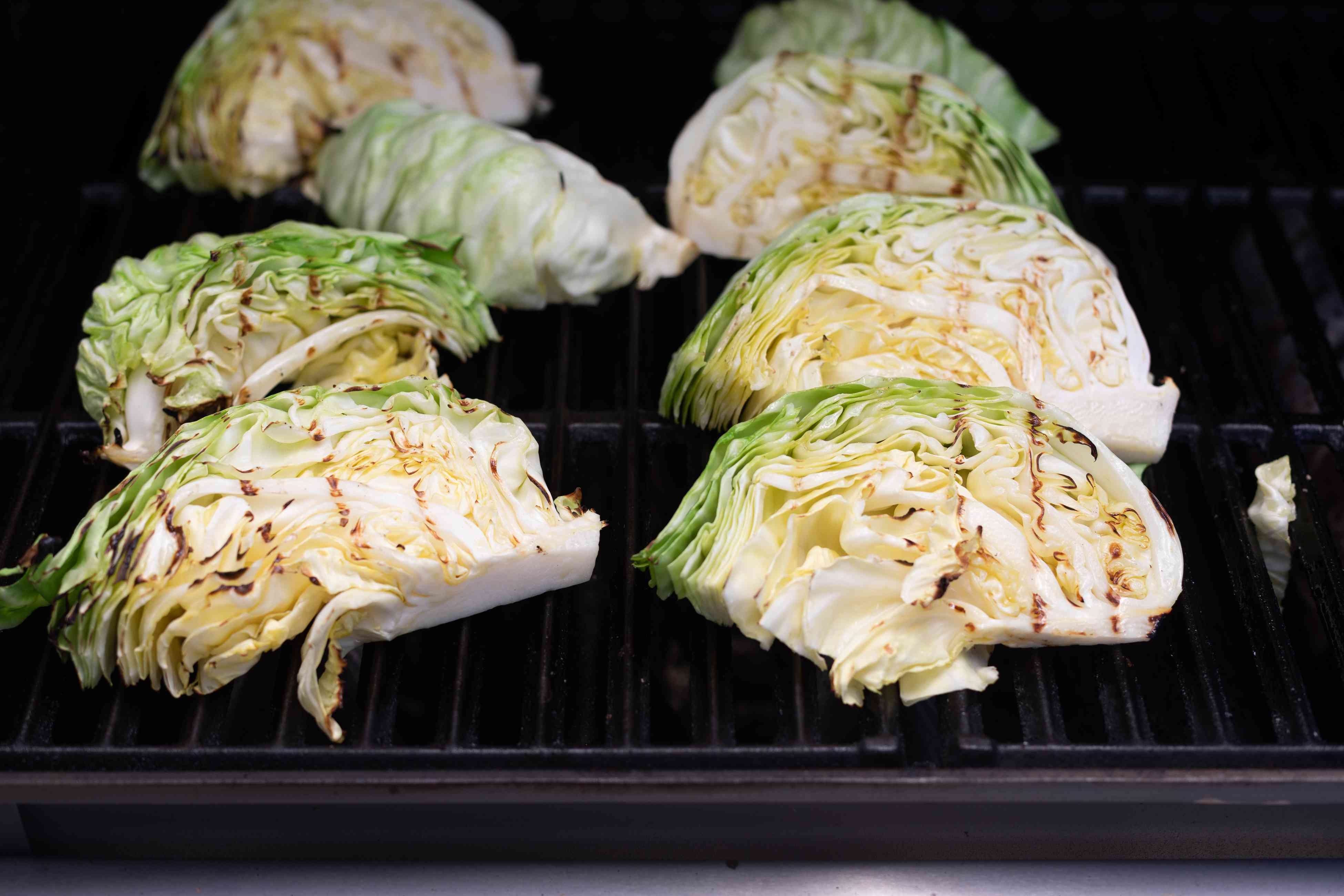 Cabbage wedges set on the grill for Grilled cabbage from Hetty McKinnon author of To Asia with Love.