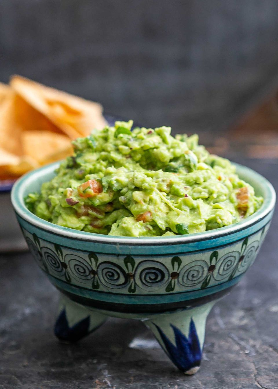 Easy guacamole served in a traditional mexican bowl
