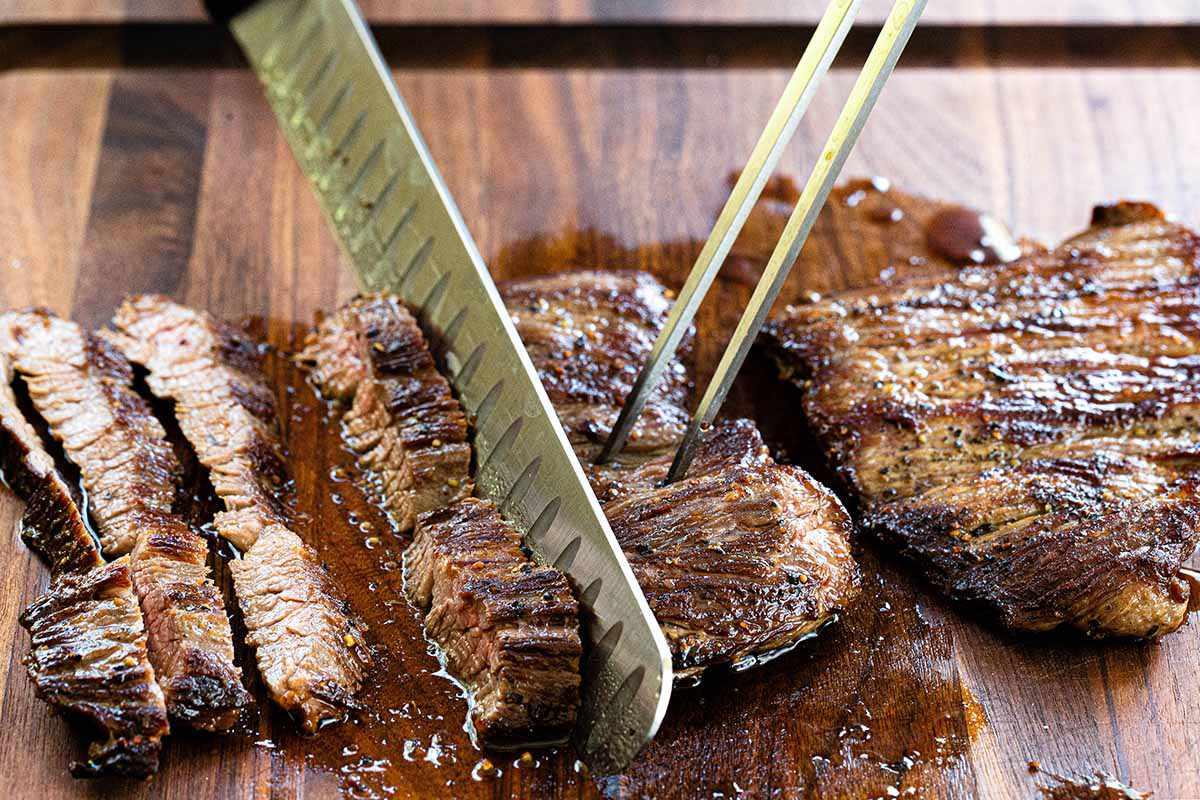 How to Cook Skirt Steak on the Stovetop - slicing steak on cutting board