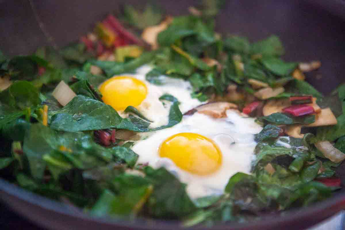 swiss chard cooked eggs in pan
