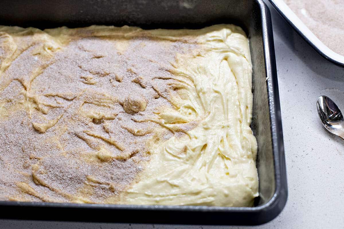 Easy Coffee Cake Recipe - cake batter with cinnamon and sugar sprinkled over the top