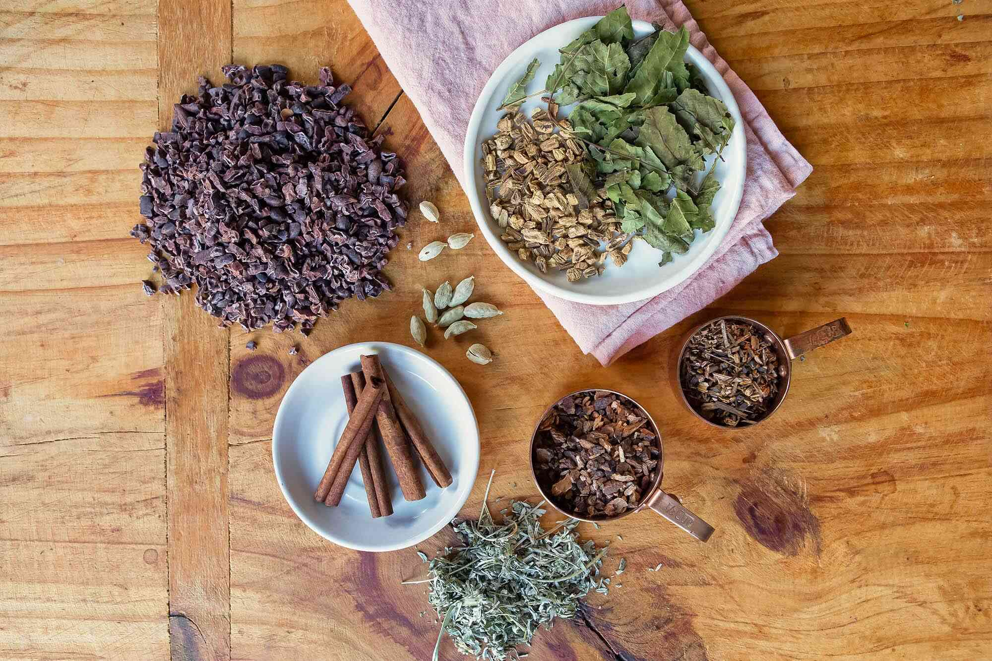 A variety of spices, herbs and roots to make Chocolate cocktail bitters.