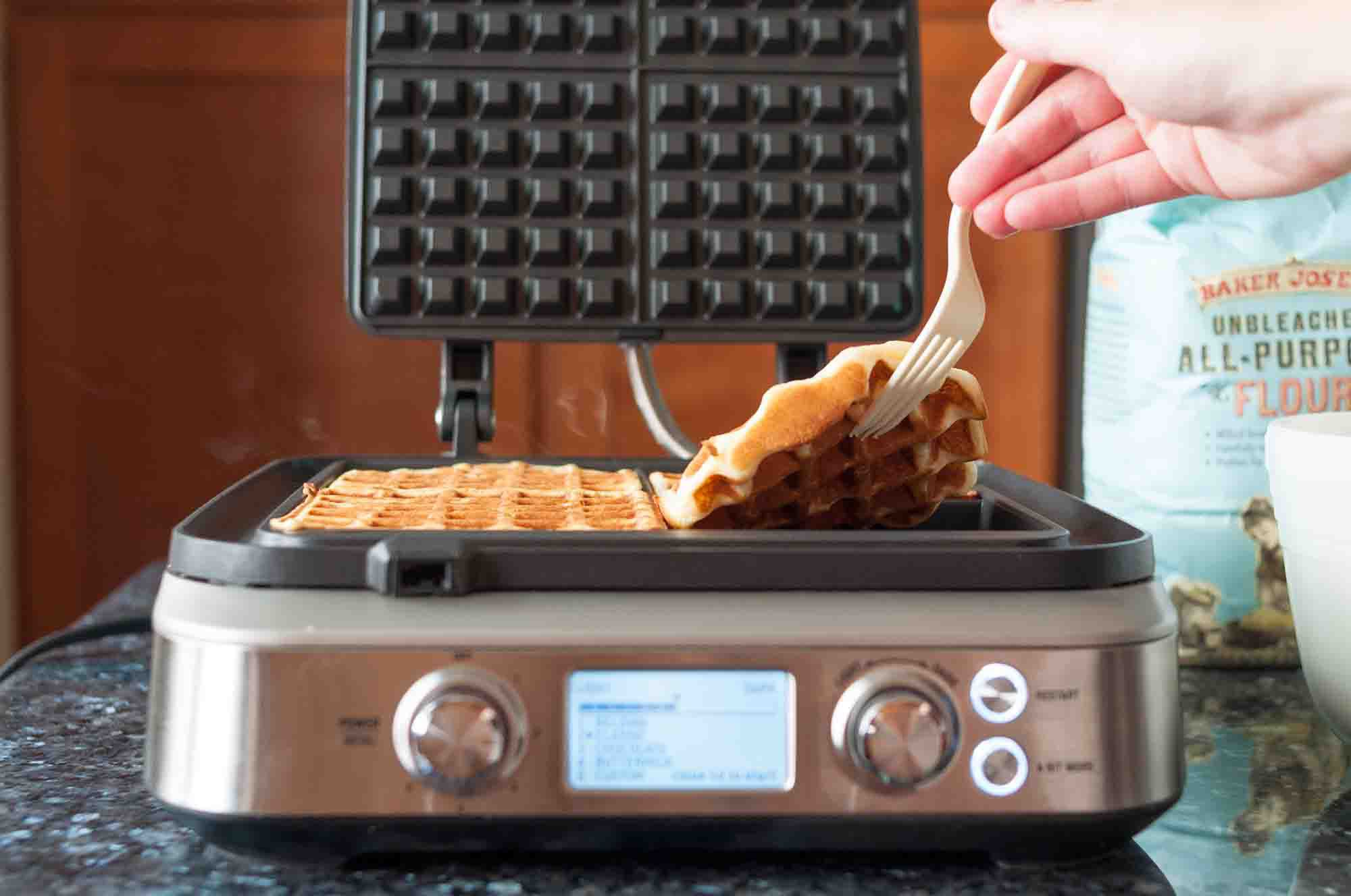 Use a fork to lift the finished waffles out of the waffle iron