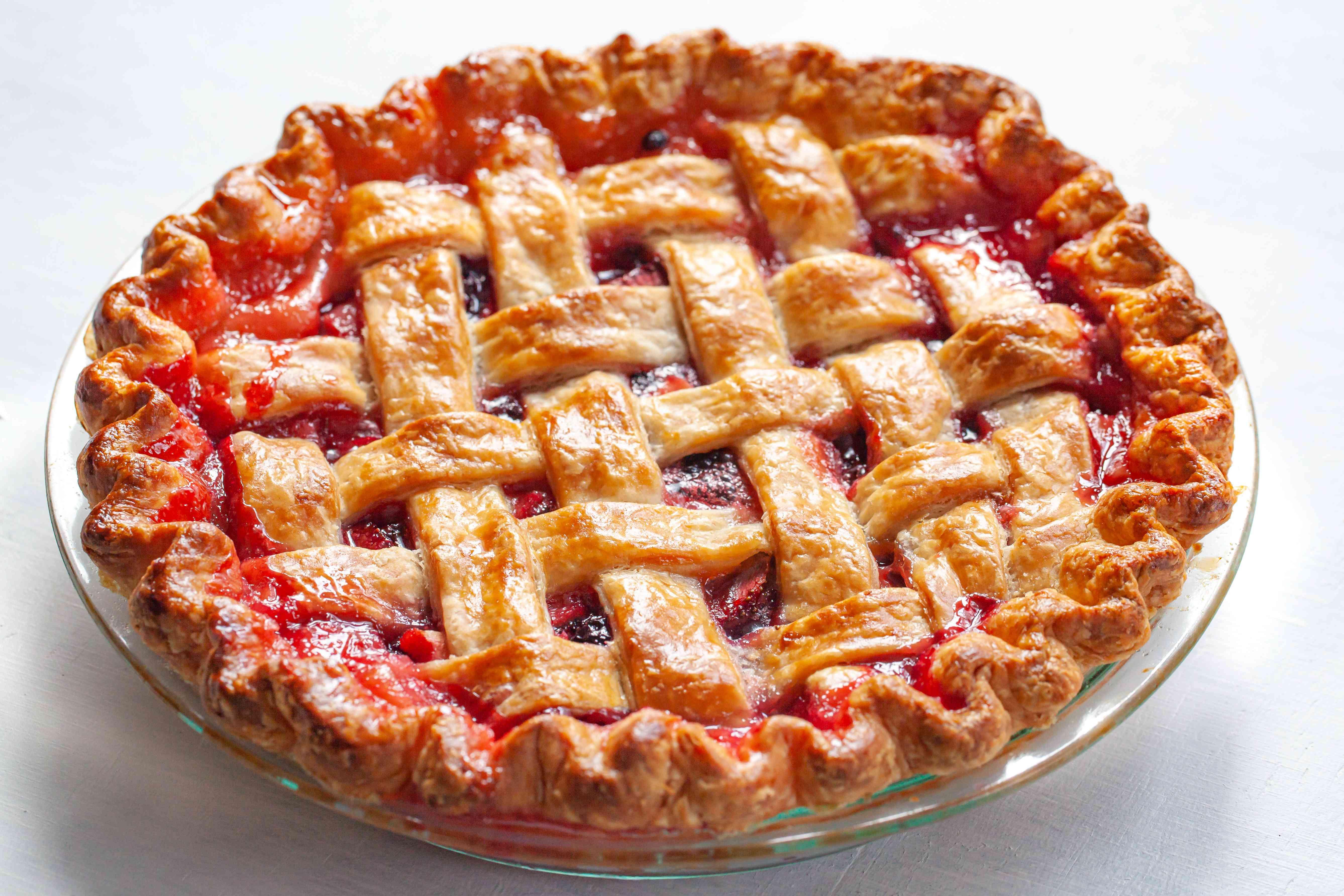 A whole pie with a lattice pie crust.