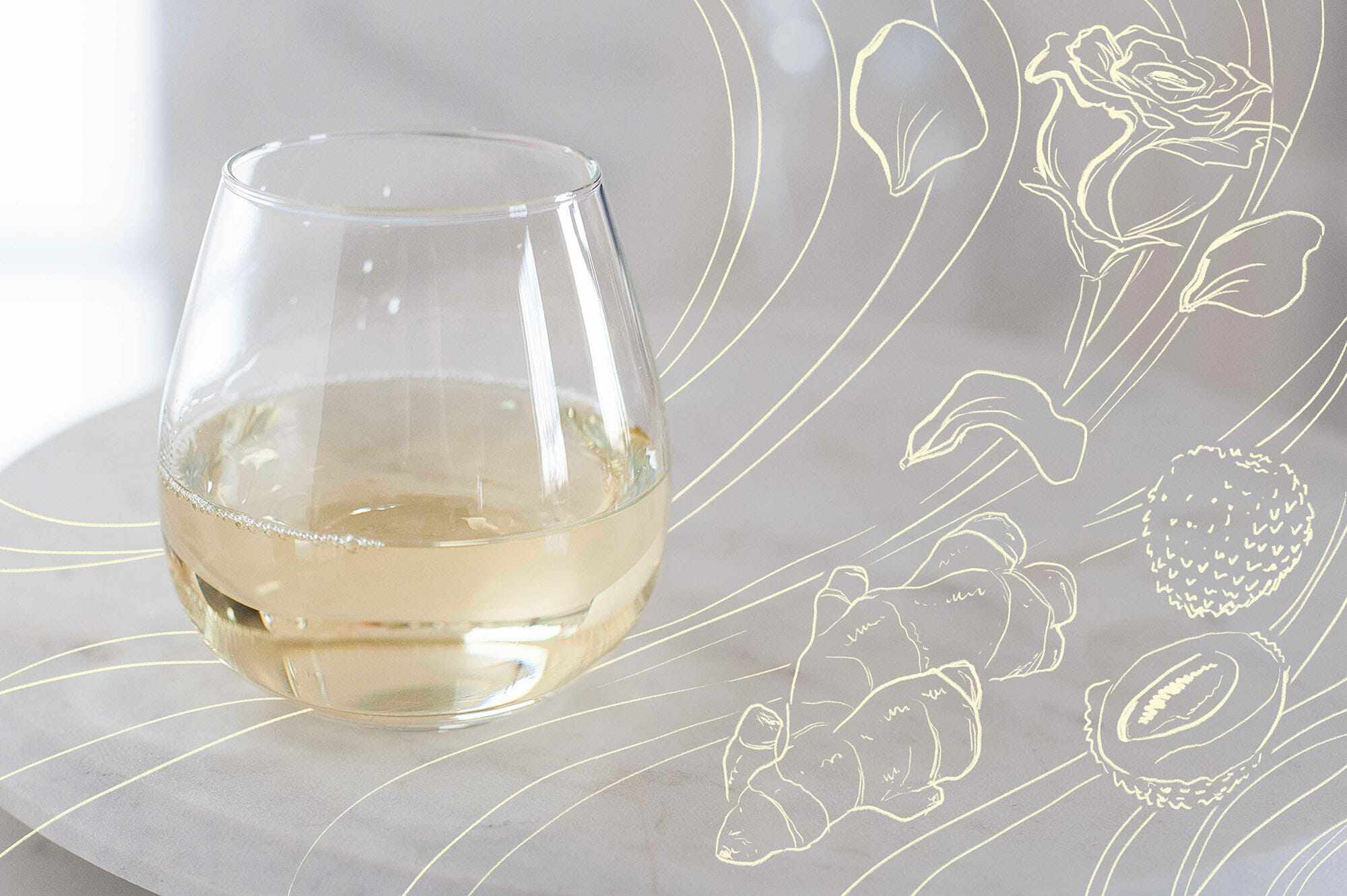 A glass of white wine with a rose, ginger and berry drawn to the right.