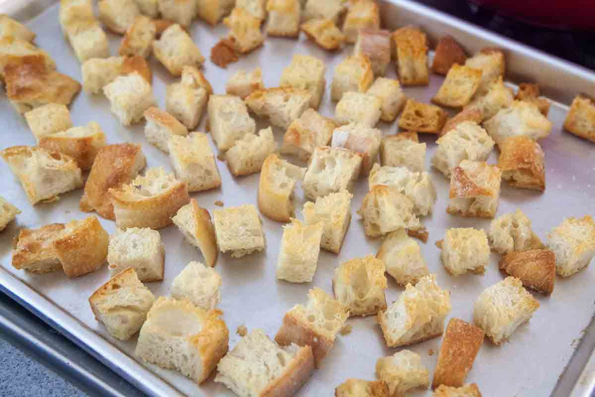 toasted cubed bread on baking sheet for panade