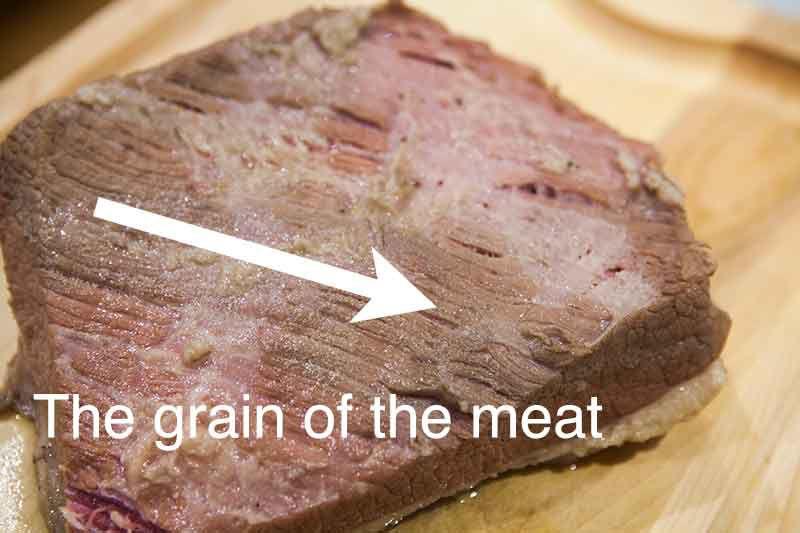 Boiled dinner corned beef slab showing grain of meat