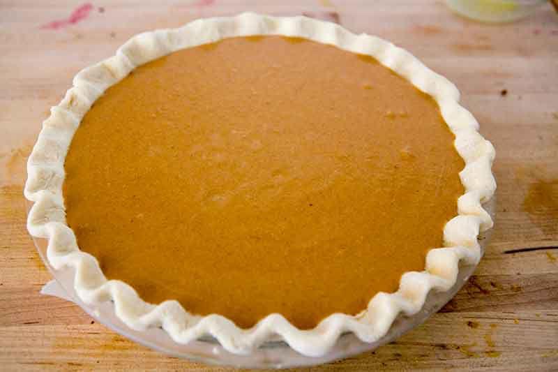 pumpkin pie in dish ready for baking