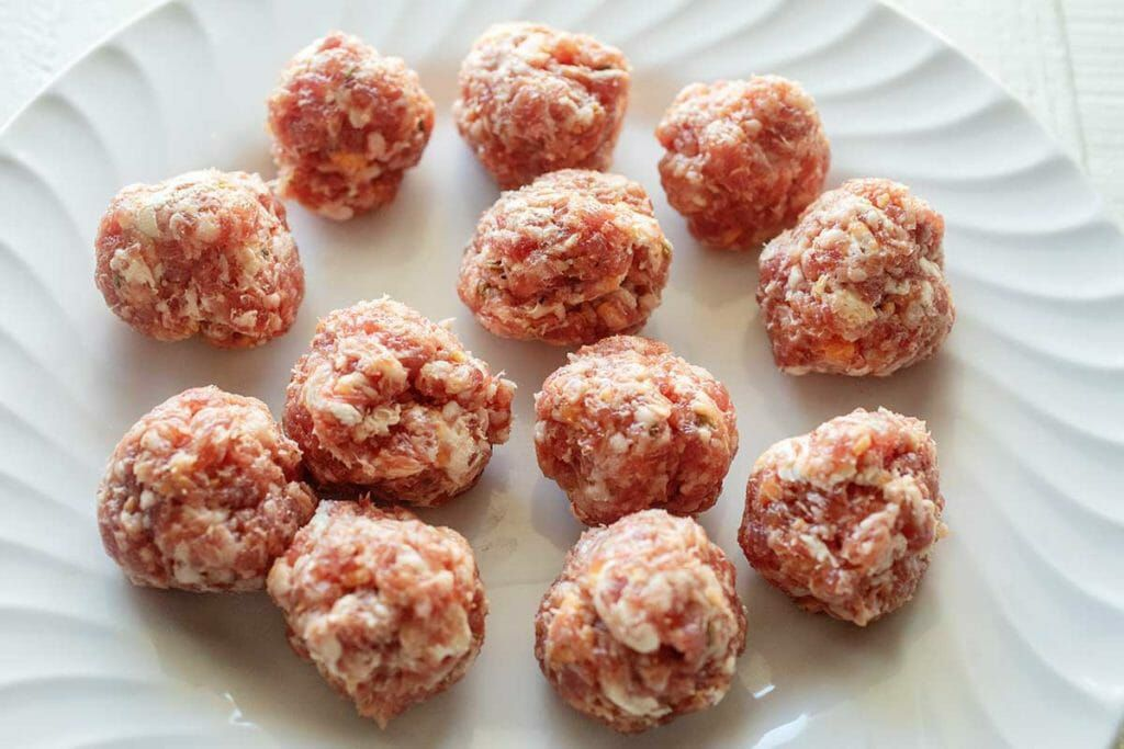 Form round sausage meatballs for slow cooker