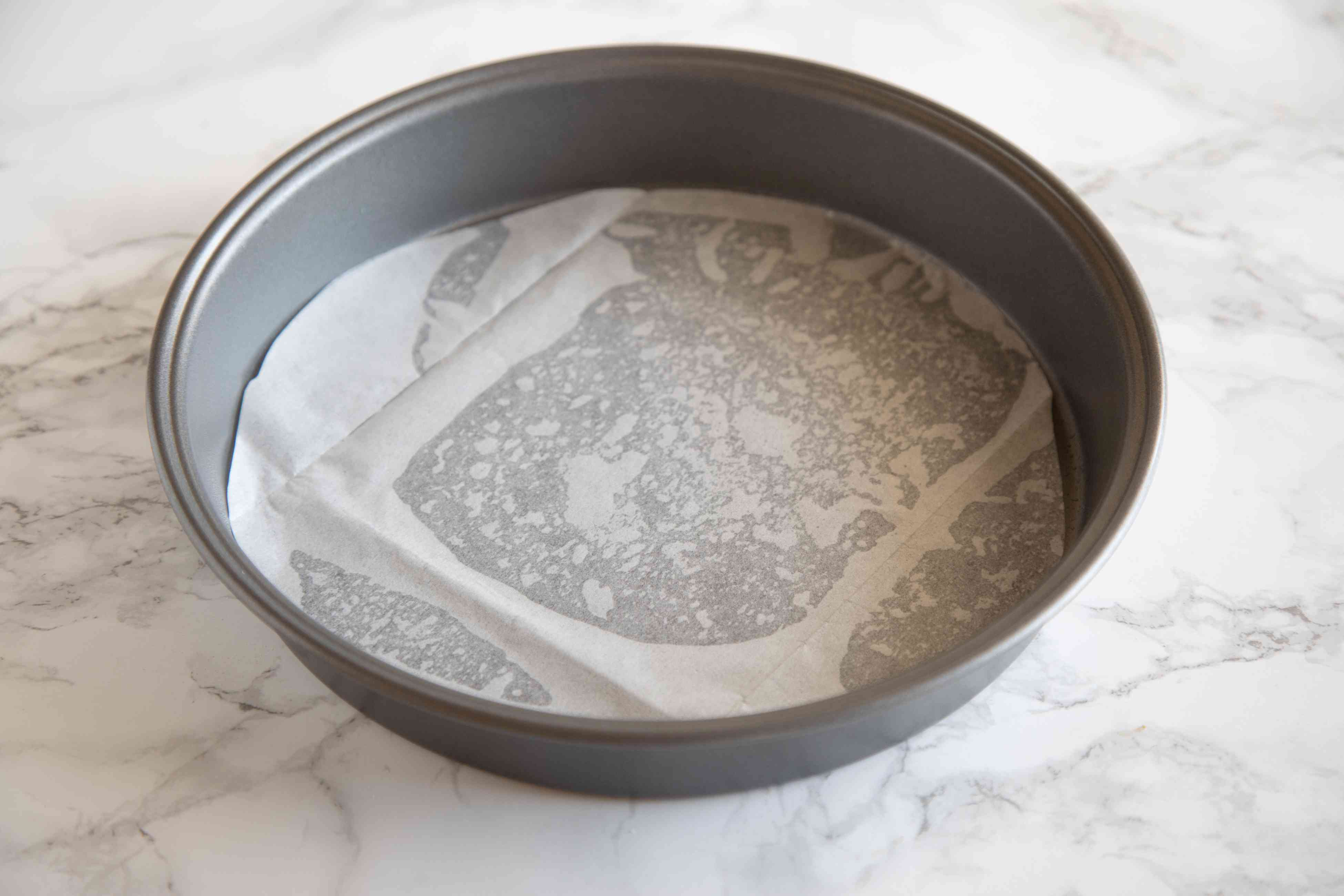 Parchment lined cake pan to make Quick and Easy Earl Grey Yogurt Cake.