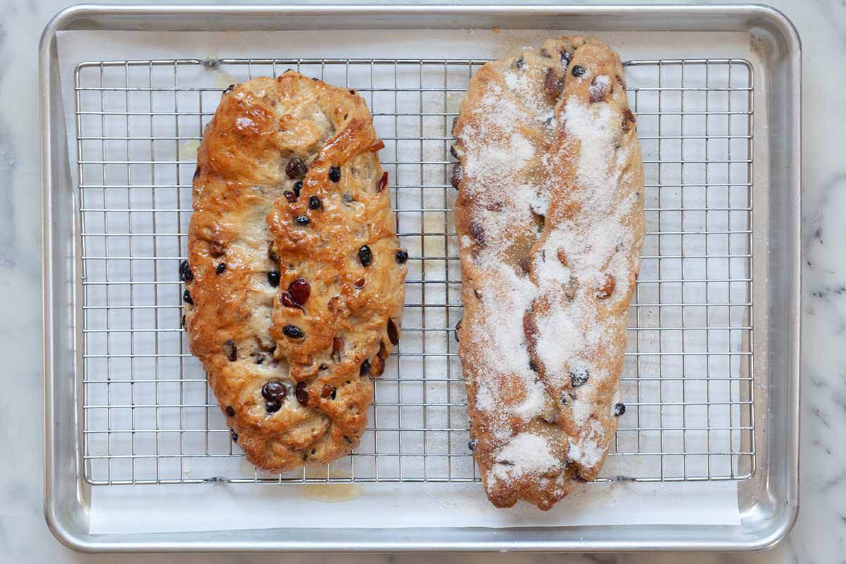 Christmas Stollen on a baking rack coated in sugar.