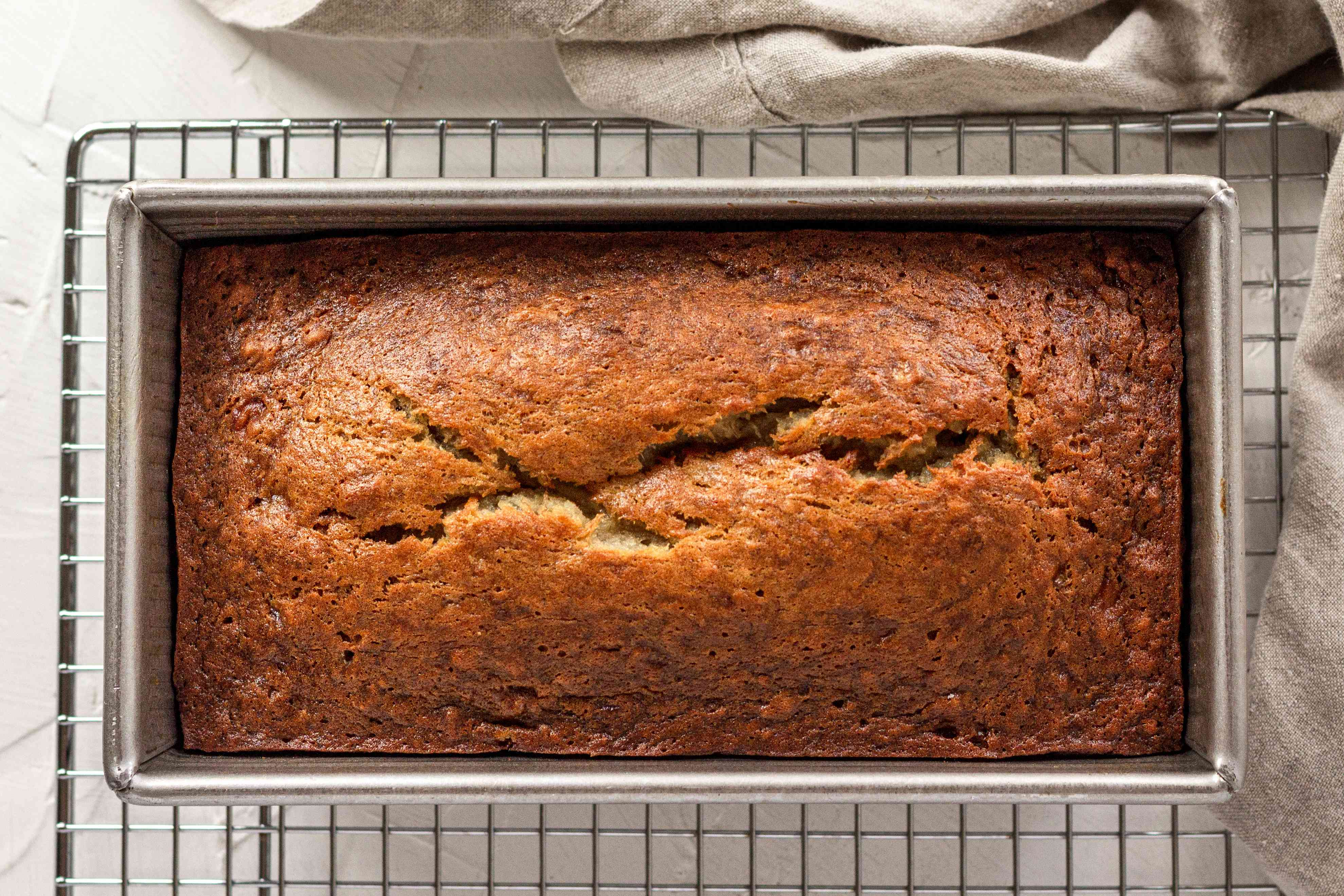 Baked banana bread in a loaf pan.