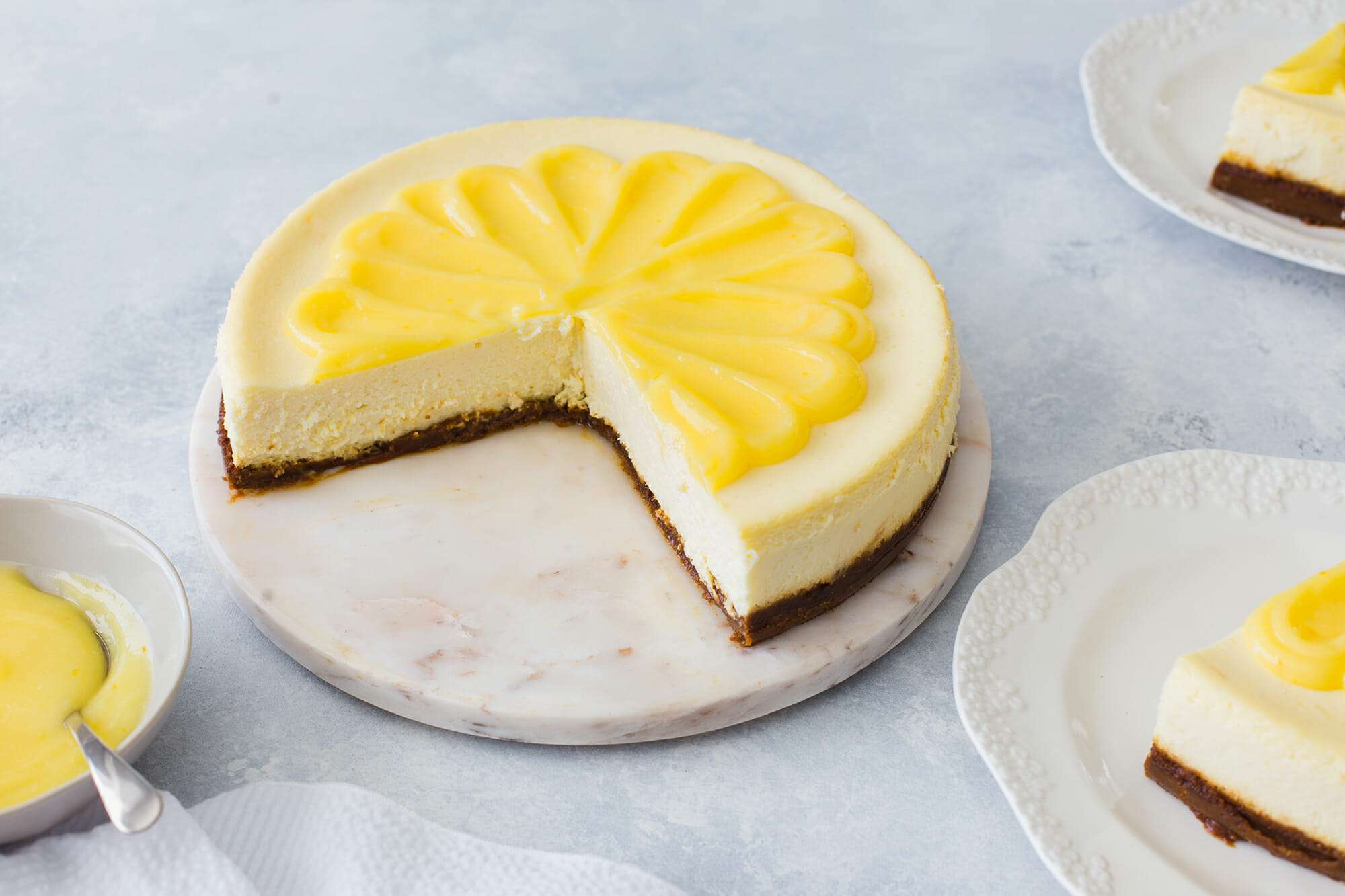Lemon Curd Cheesecake - Lemon cheese cake with 1/4 of the slices removed