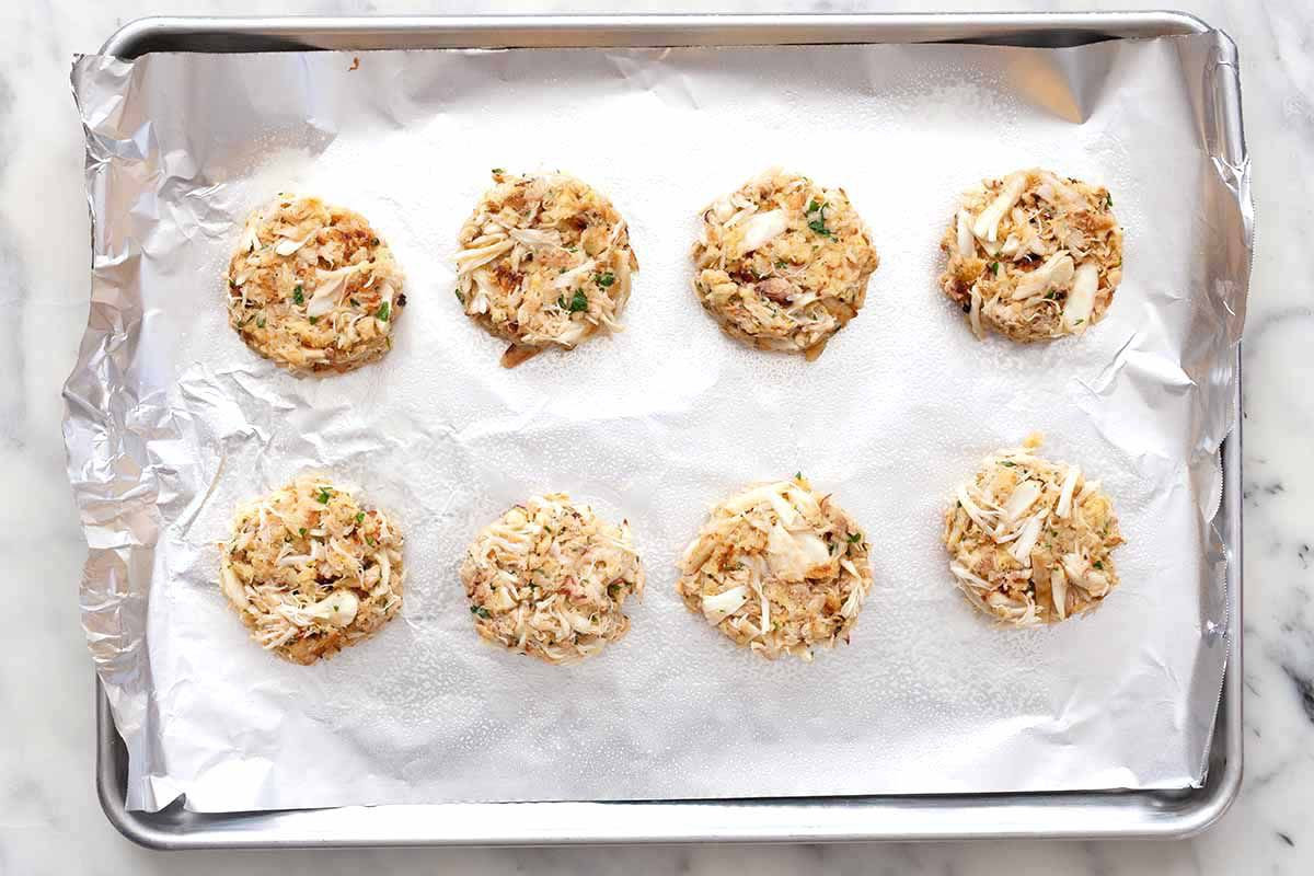 Eight Maryland Crabcakes on a sheetpan lined with aluminum foil