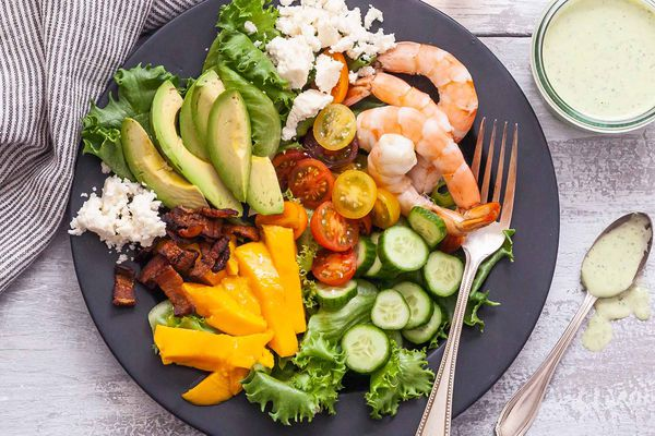 Seafood Cob Salad - shrimp and vegetables on gray plate with glass of rose