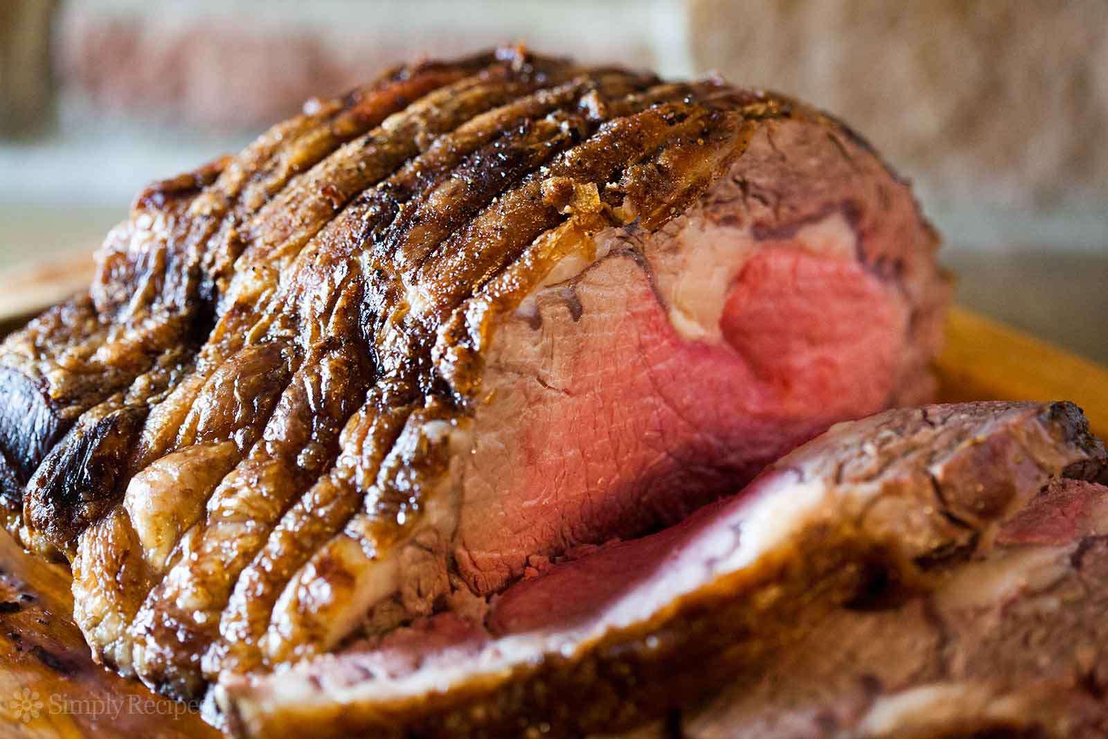 Sliced prime rib roast on a platter