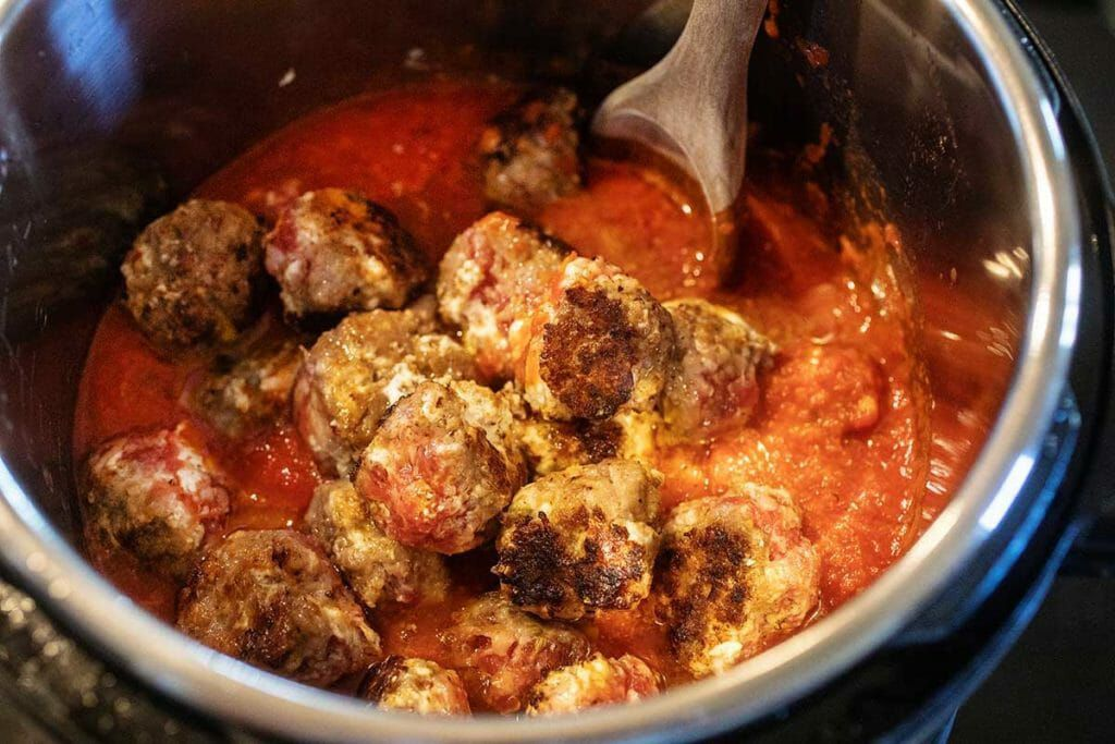 Put browned sausage balls into the slow cooker pot