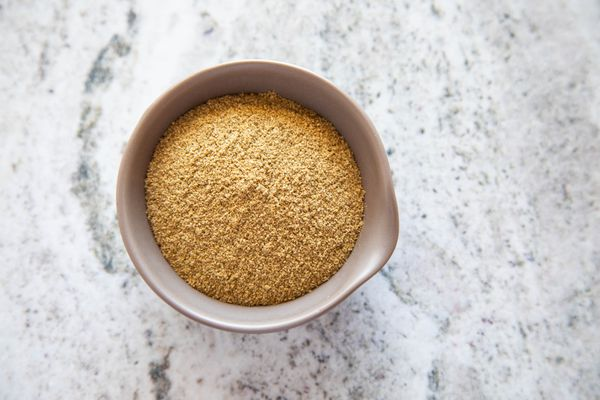 Adobo seasoning spice in a brown bowl