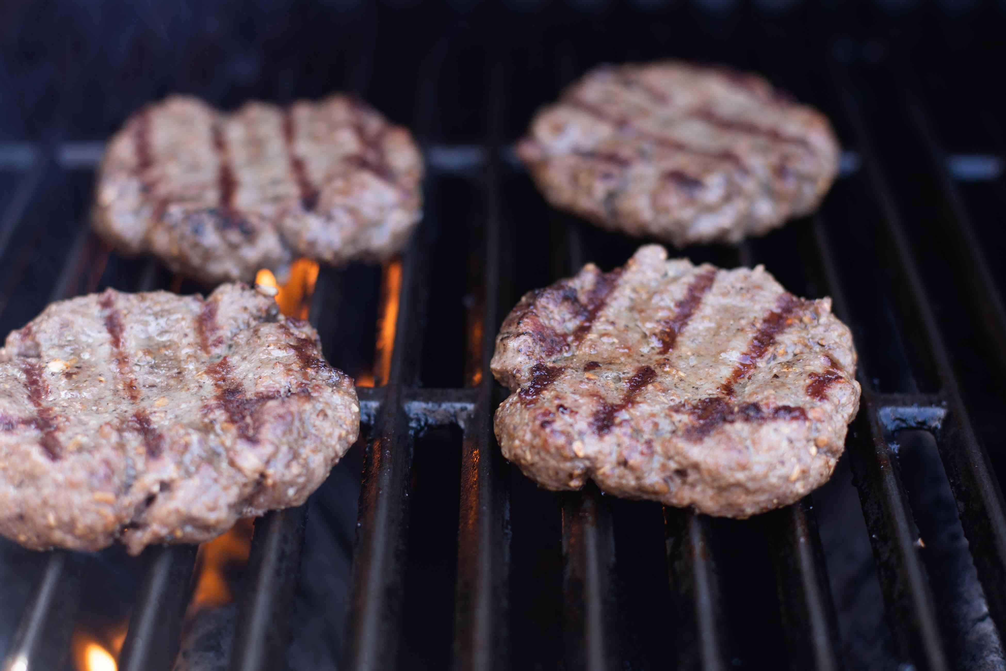 Grilling mushroom swiss burgers.