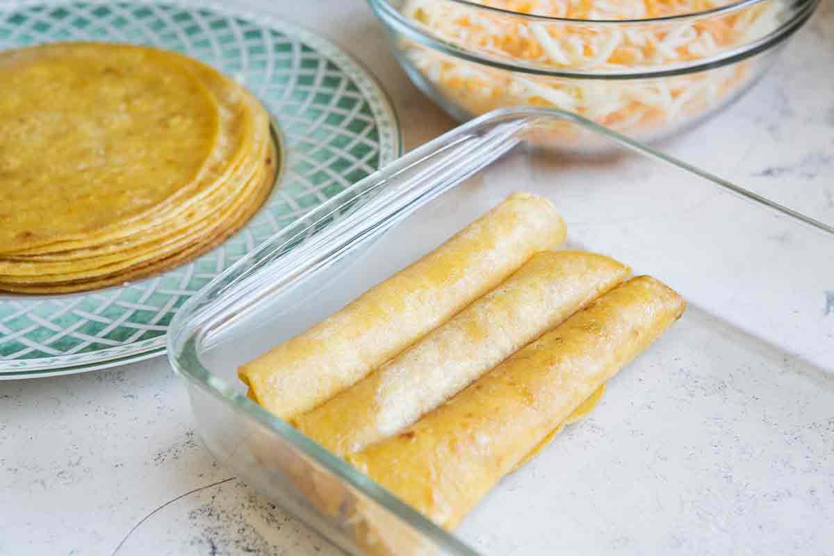 add rolled tortillas to enchilada casserole dish