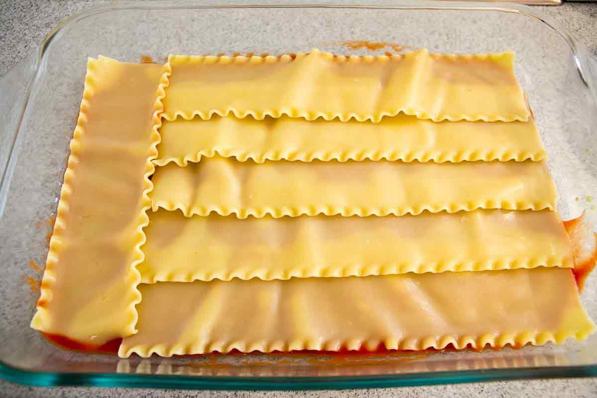 Vegetarian Zucchini Lasagna Layering vegetable lasagna in pyrex dish