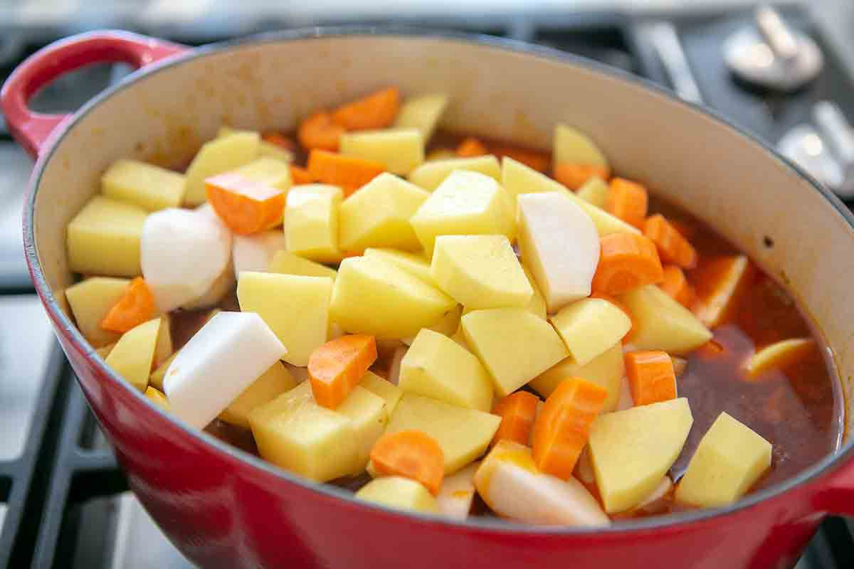 add root vegetables to short rib stew