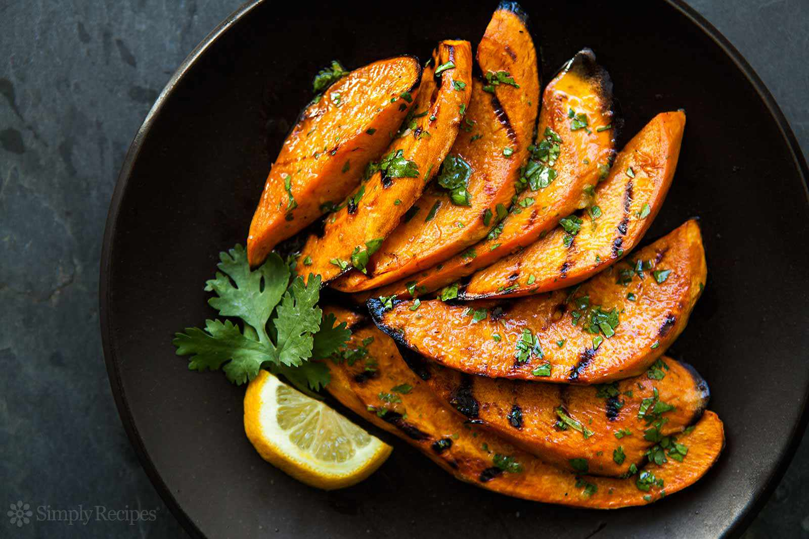 Plate with slices of grilled sweet potatoes