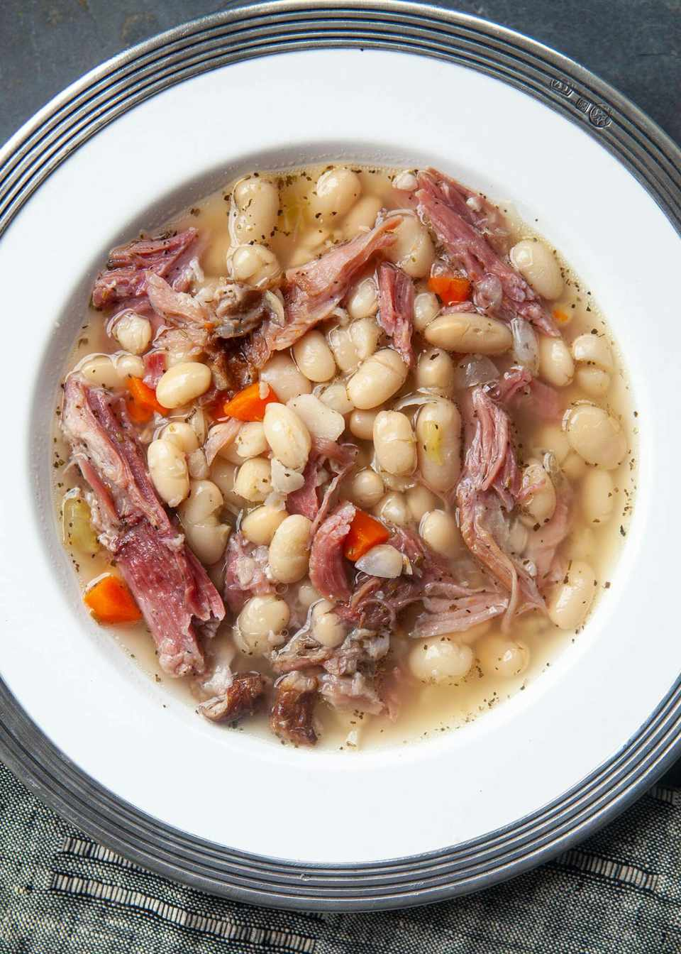 ham and bean soup served in a white bowl