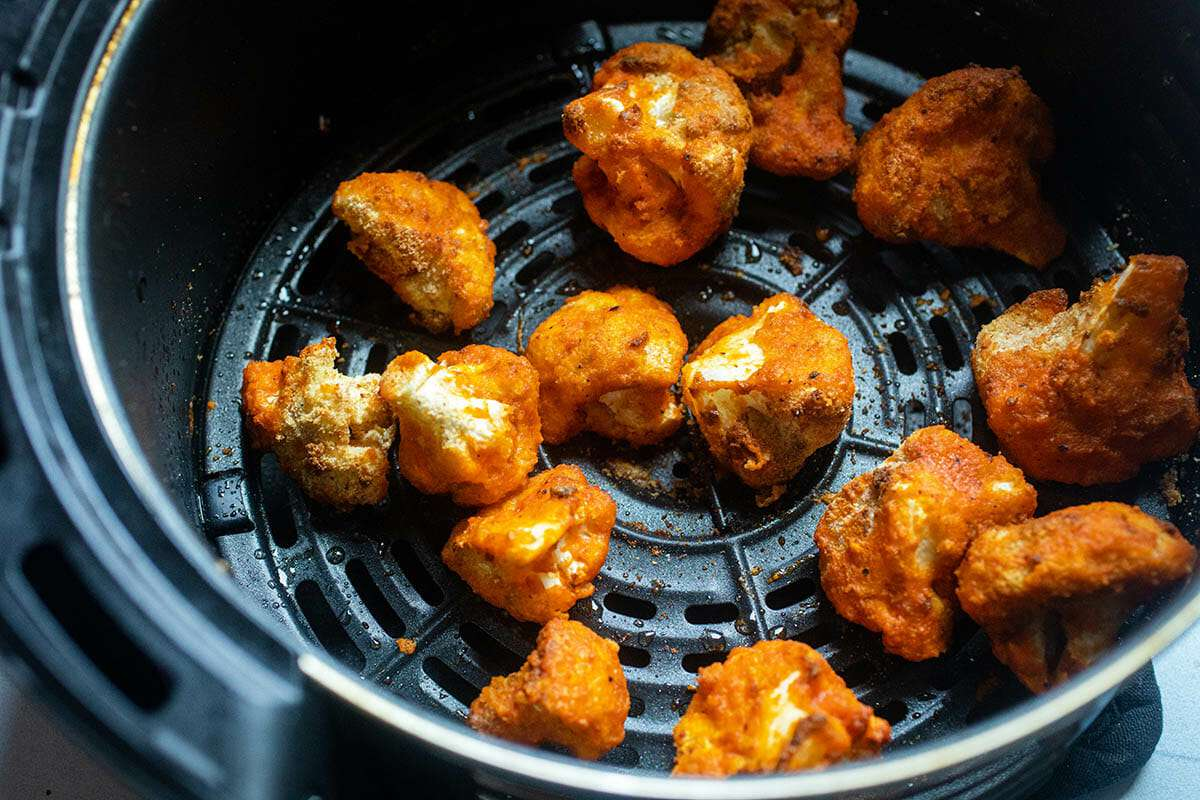 Air Fryer Cauliflower with Buffalo Sauce in an air fryer.