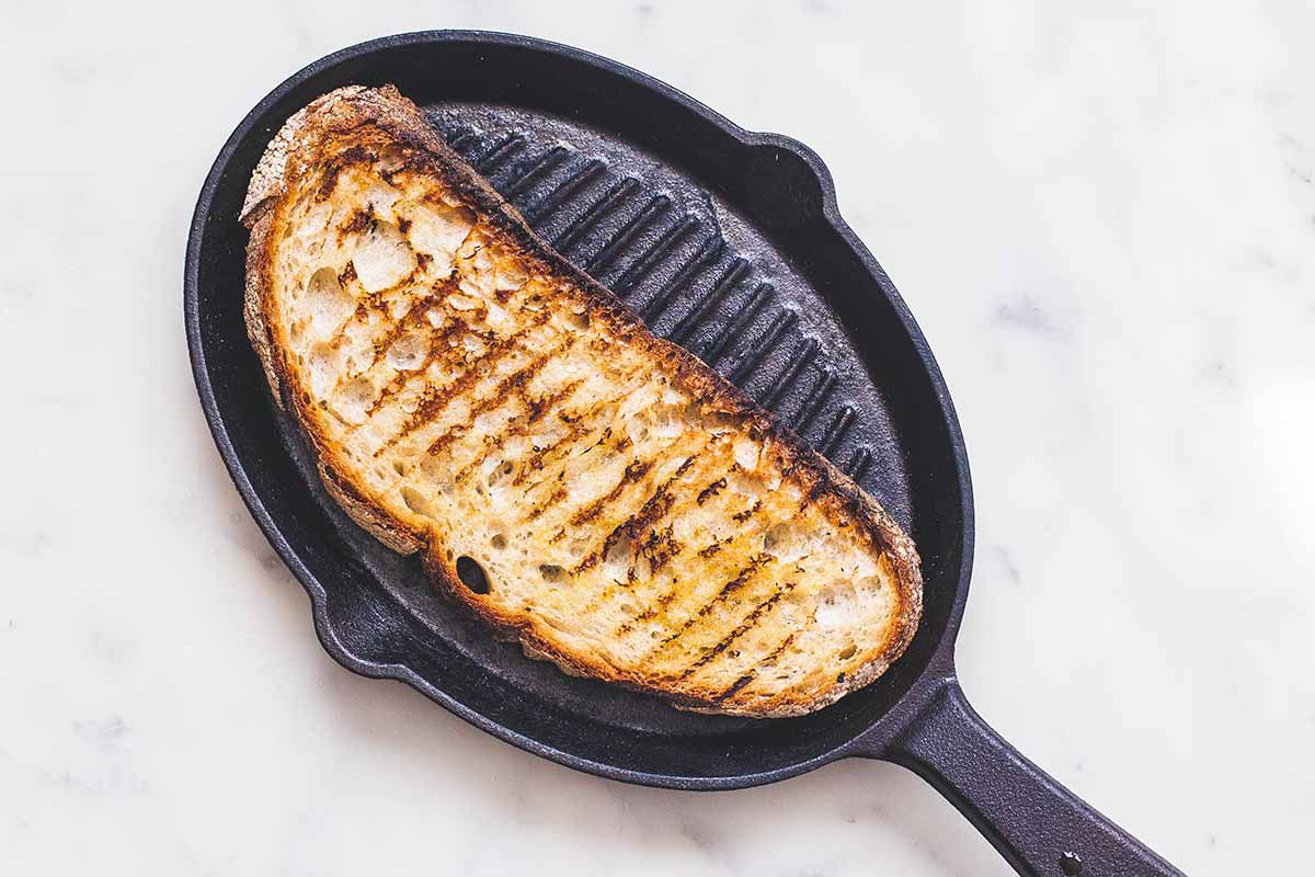 Easy Side Salad - piece of grilled bread on pan grill